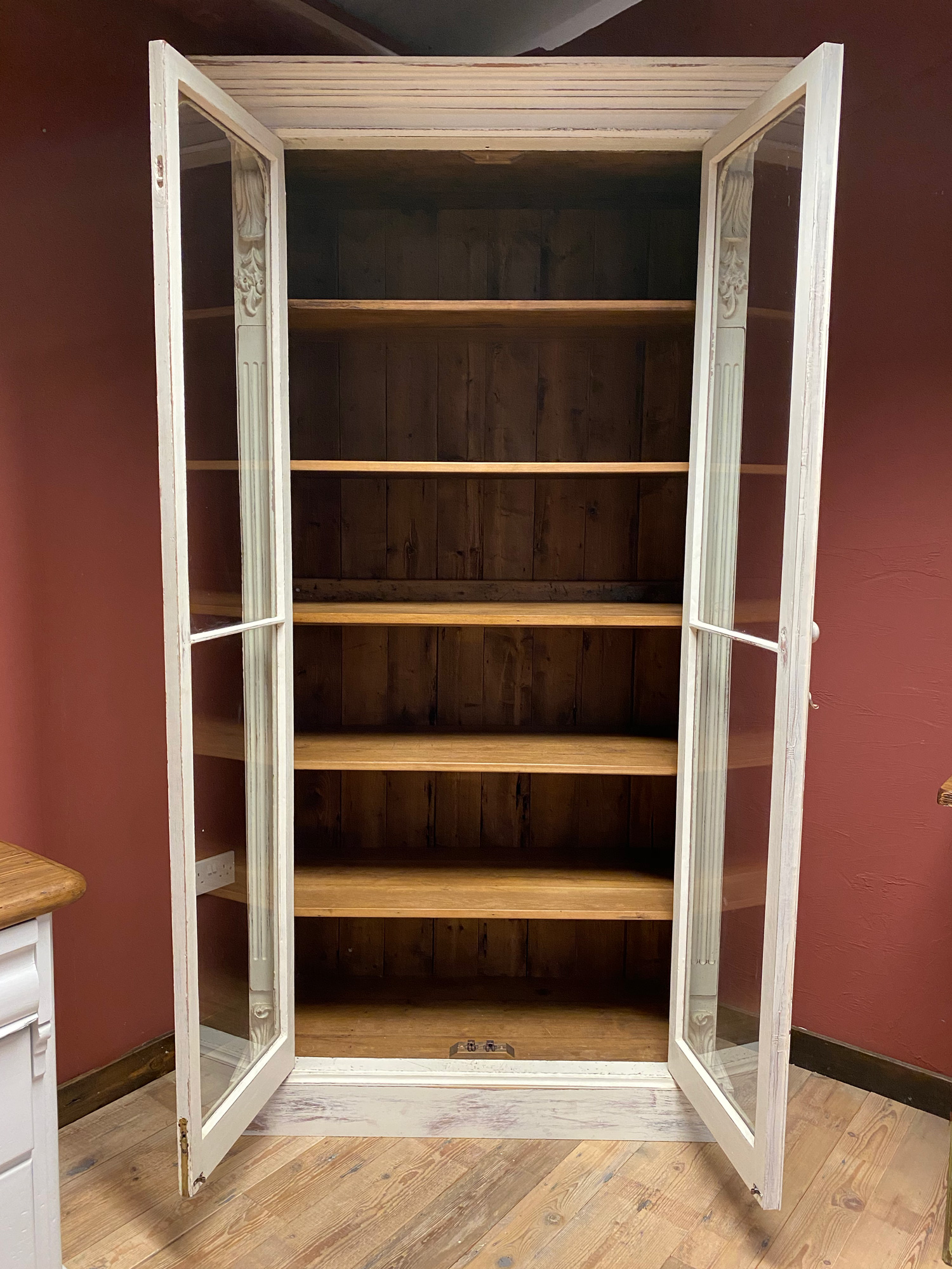Original glazed bookcase with doors open