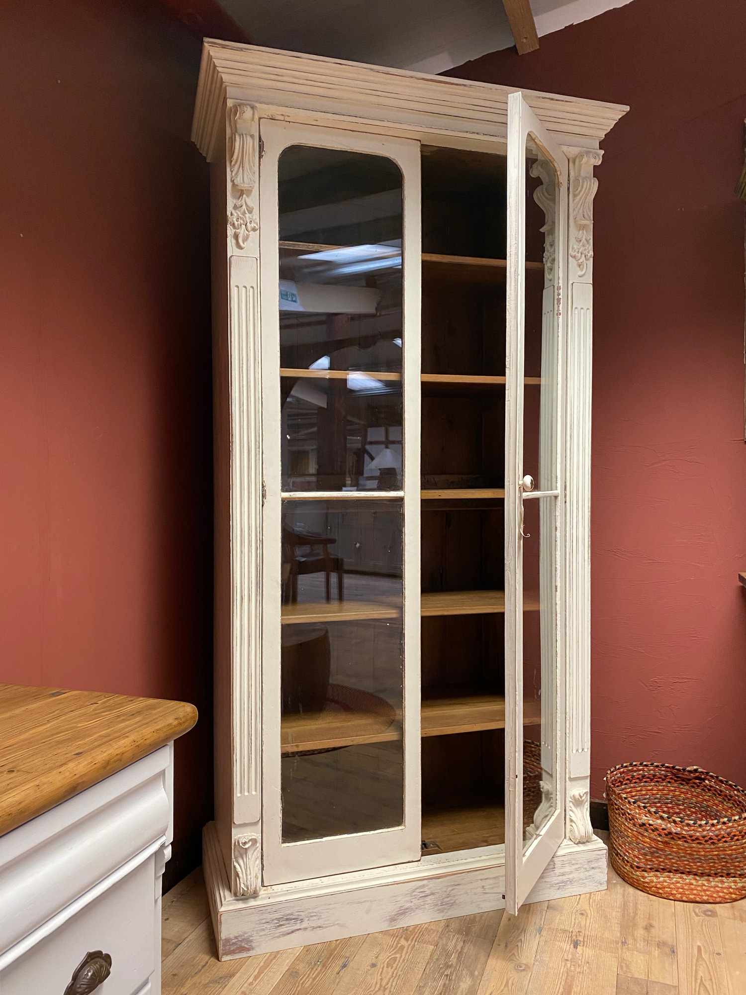 Single door open on tall glazed original bookcase