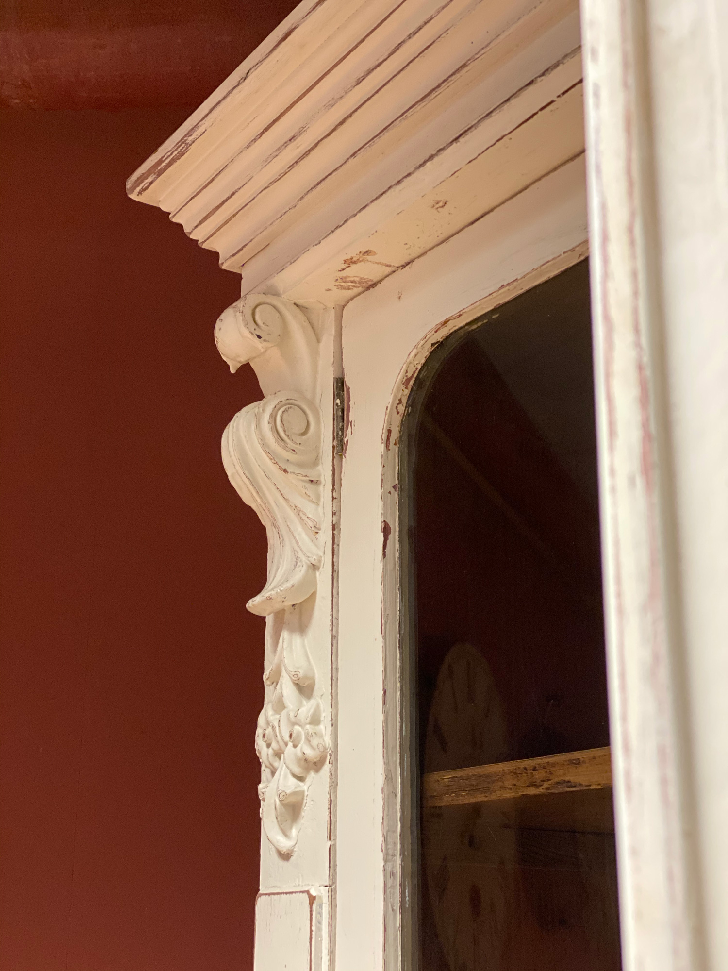 Carved detail on original painted bookcase
