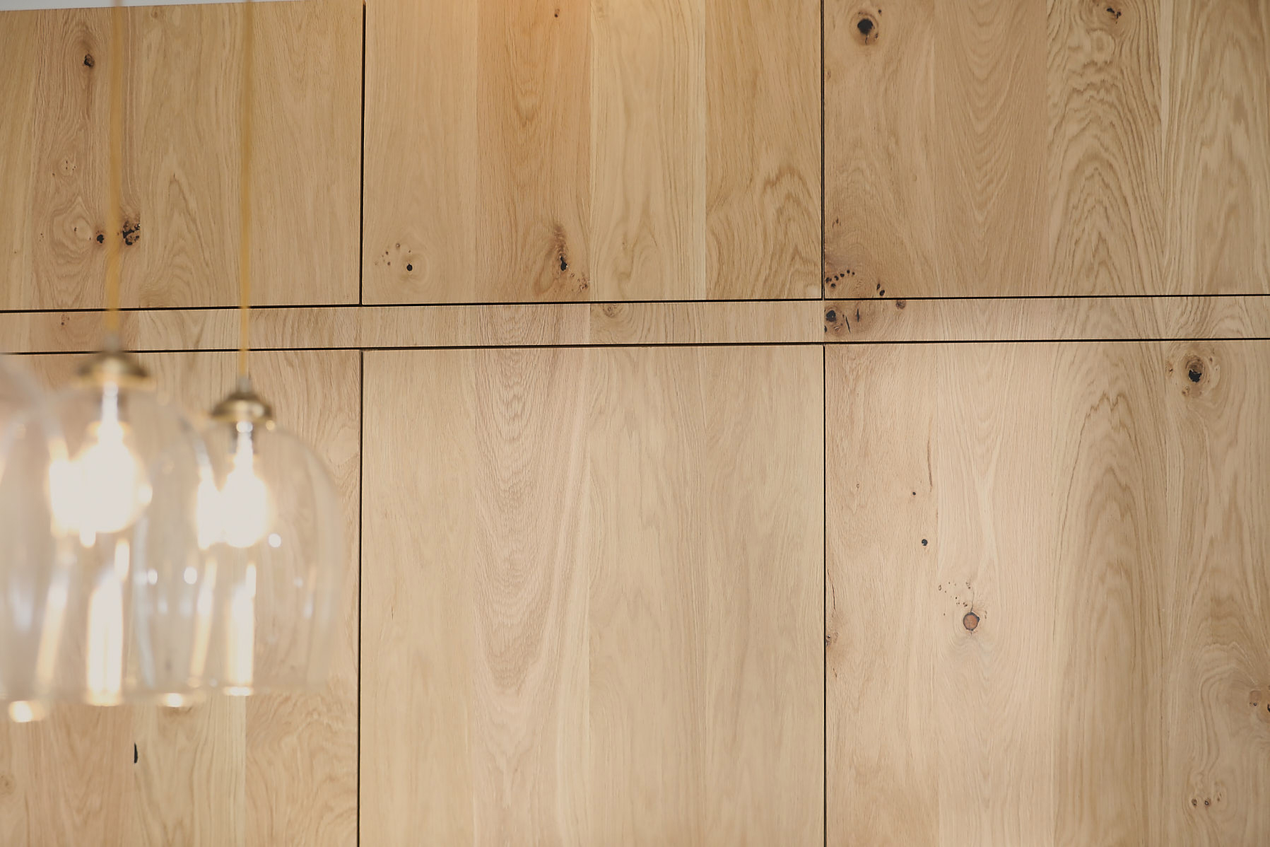Tall oak cabinets with seamless grain running across doors