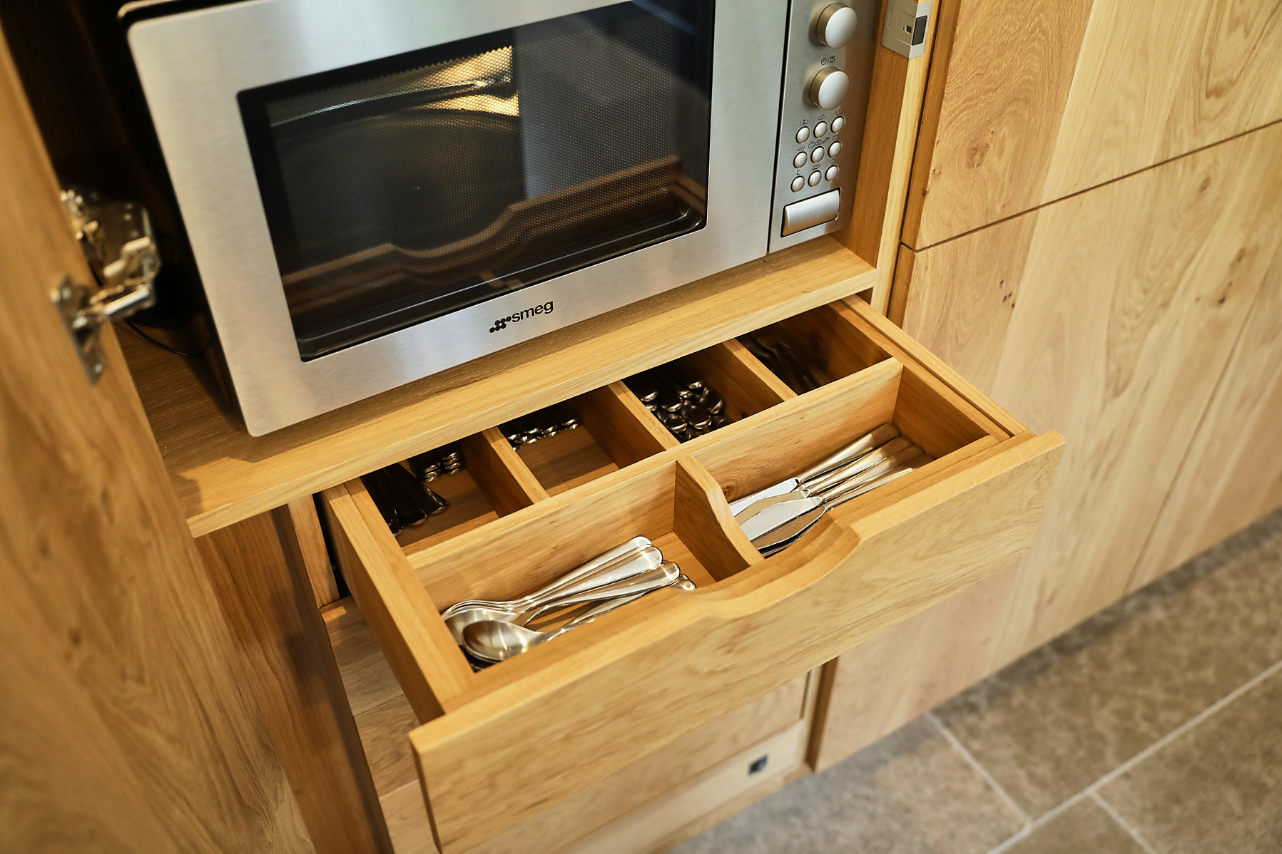 Solid oak cutlery insert in tall kitchen cabinets separates knives and spoons