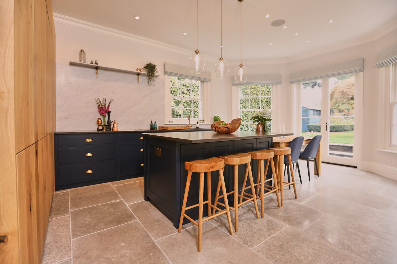Oak barstools under Little Greene blue bespoke kitchen island