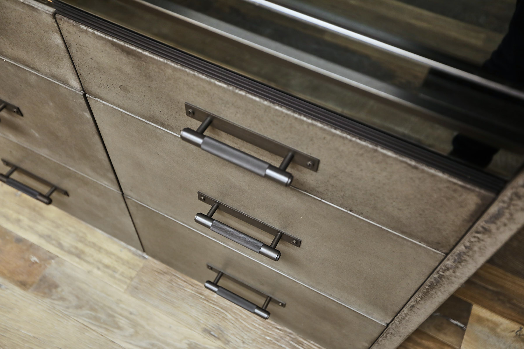 Solid concrete drawer fronts with buster and punch pull handles