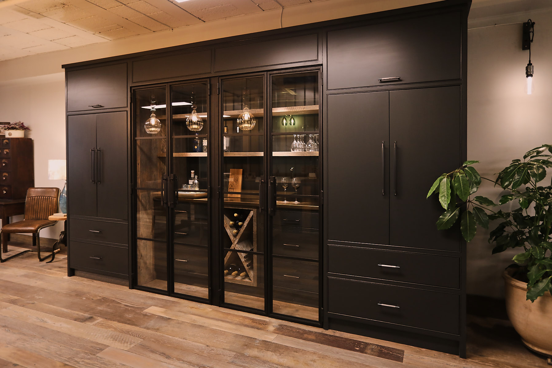 Tall kitchen cabinets painted in lamp black with crittall style doors