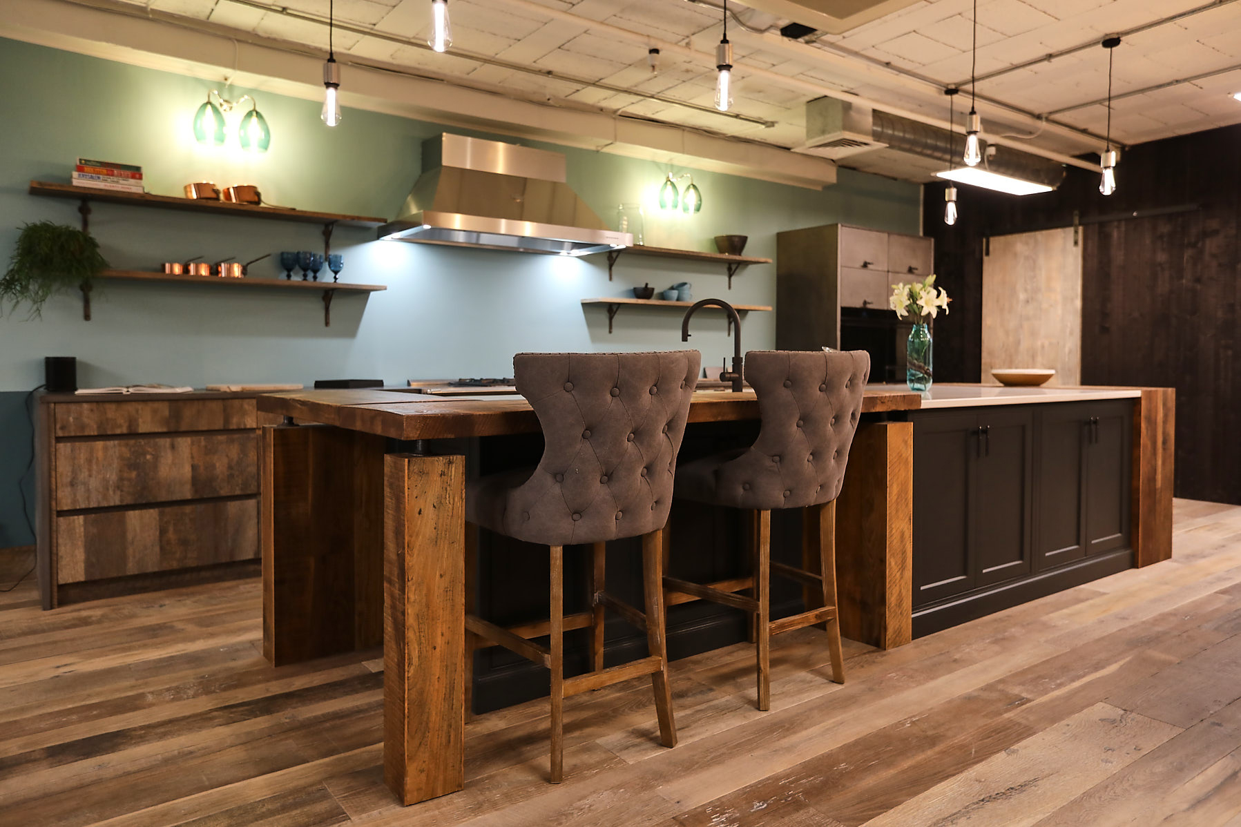 upholstered bar stools under bespoke rustic breakfast bar