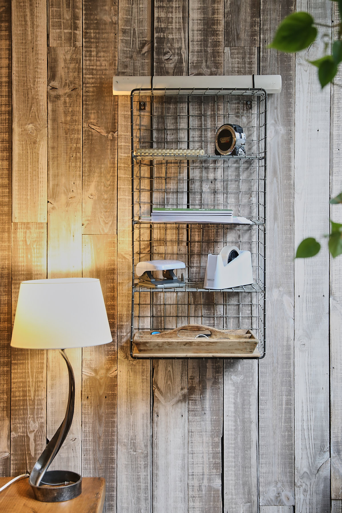 Rustic wall cladding with wire shelf