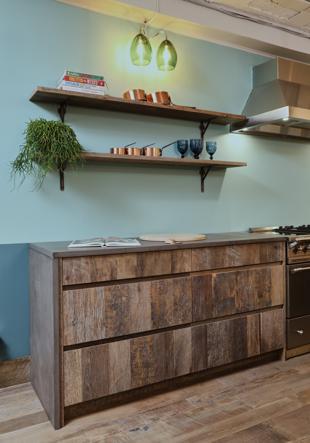 Reclaimed pan drawers with concrete kitchen worktop