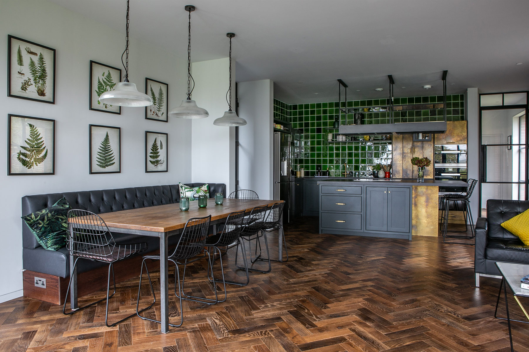 Open plan kitchen diner with parquet wood flooring