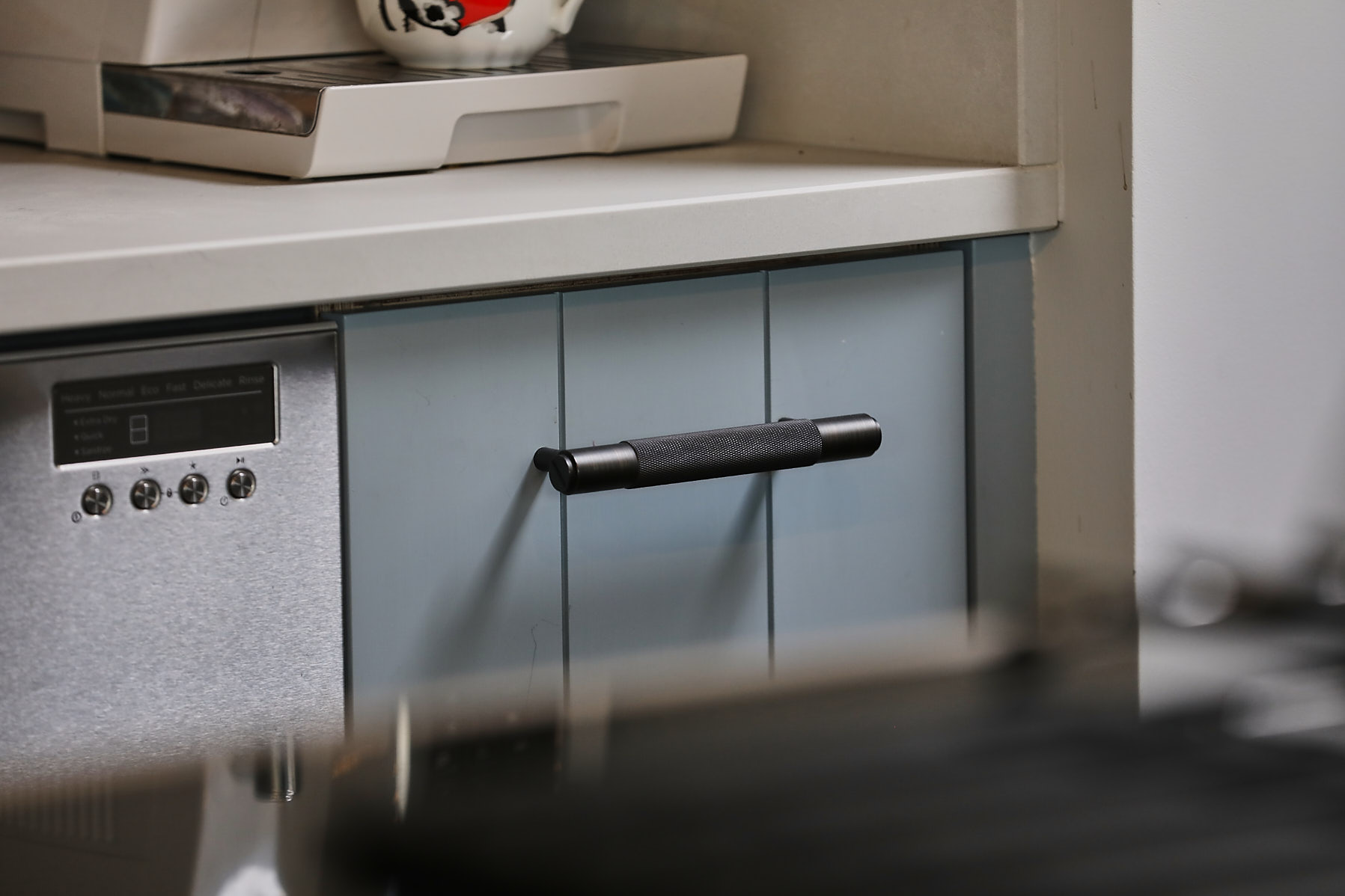 Buster and Punch bar pull on kitchen cabinet