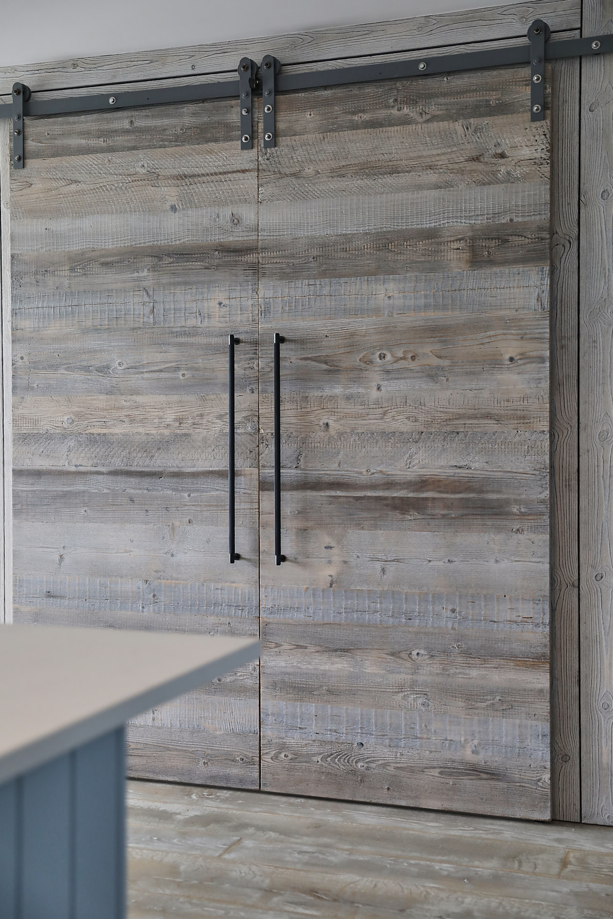 Rustic barn sliding door with Buster and Punch handles