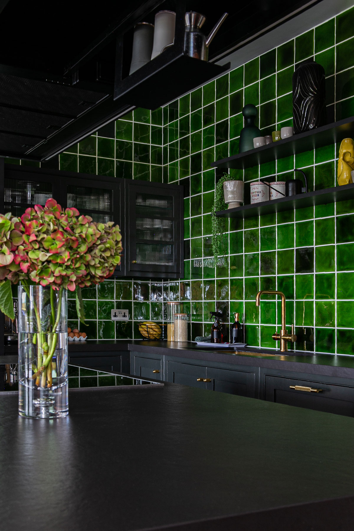 Green tiles make kitchen backsplash
