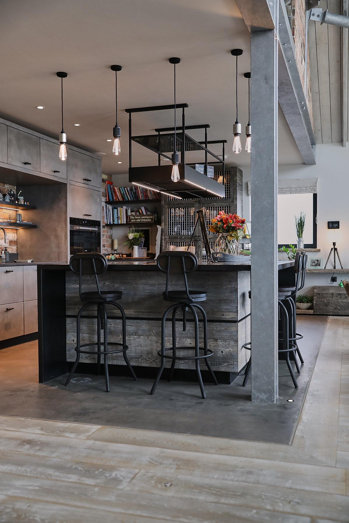 Metal bar stool under reclaimed kitchen island
