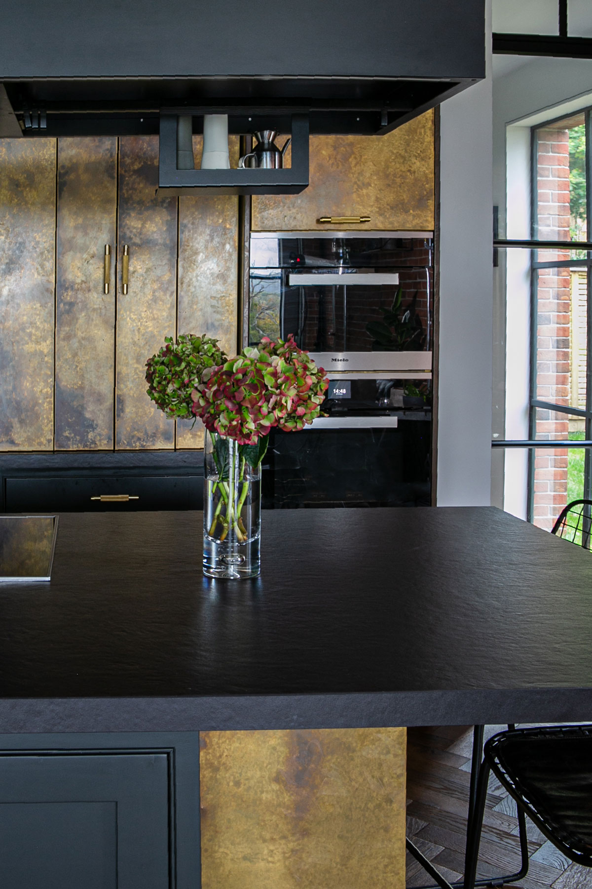 Flowers on bespoke kitchen island