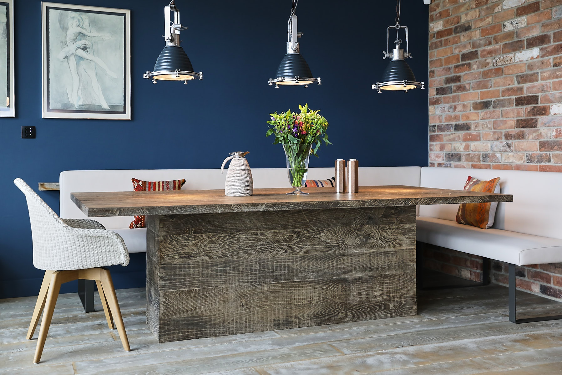 Oak dining table with blue wall