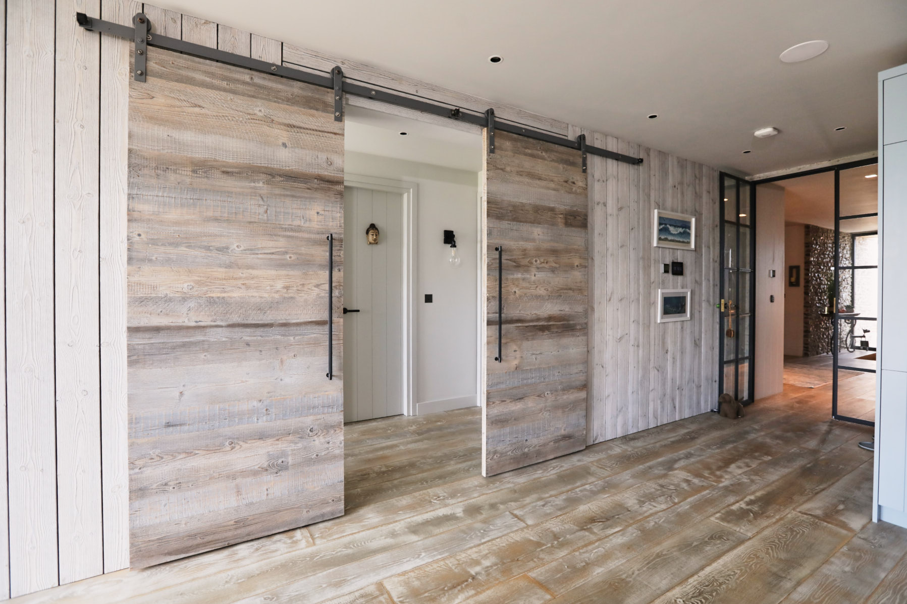 Barn sliding door with metal rail