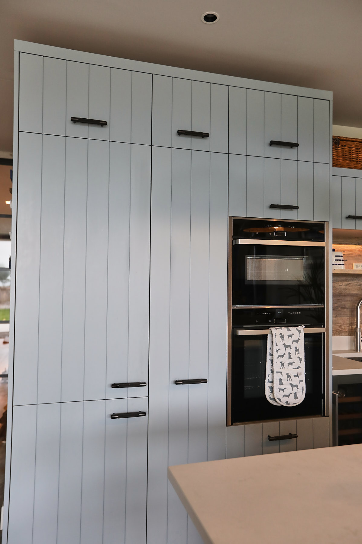 Tall integrated eye level Siemens oven in blue kitchen cabinet