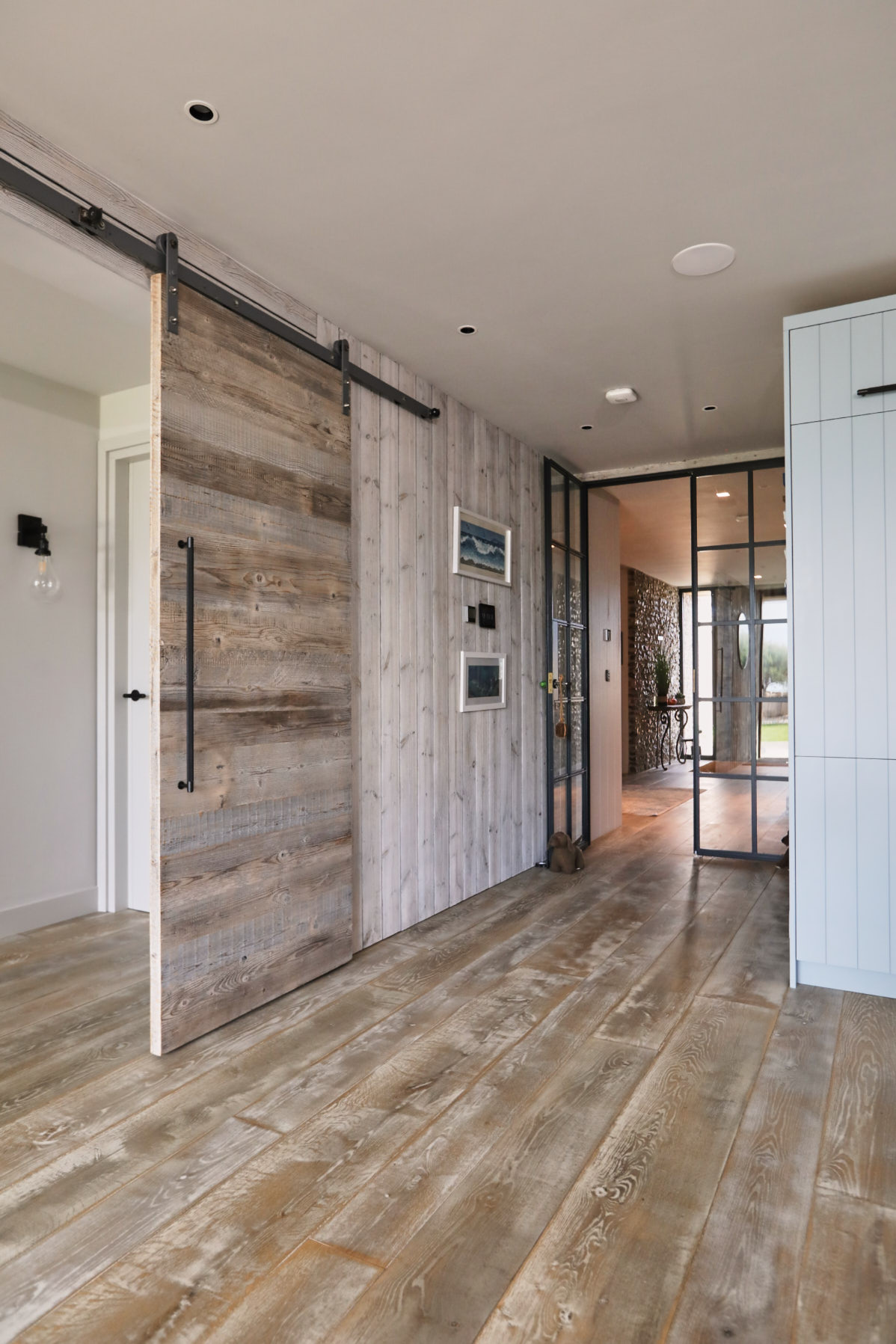 Open barn door with wooden flooring