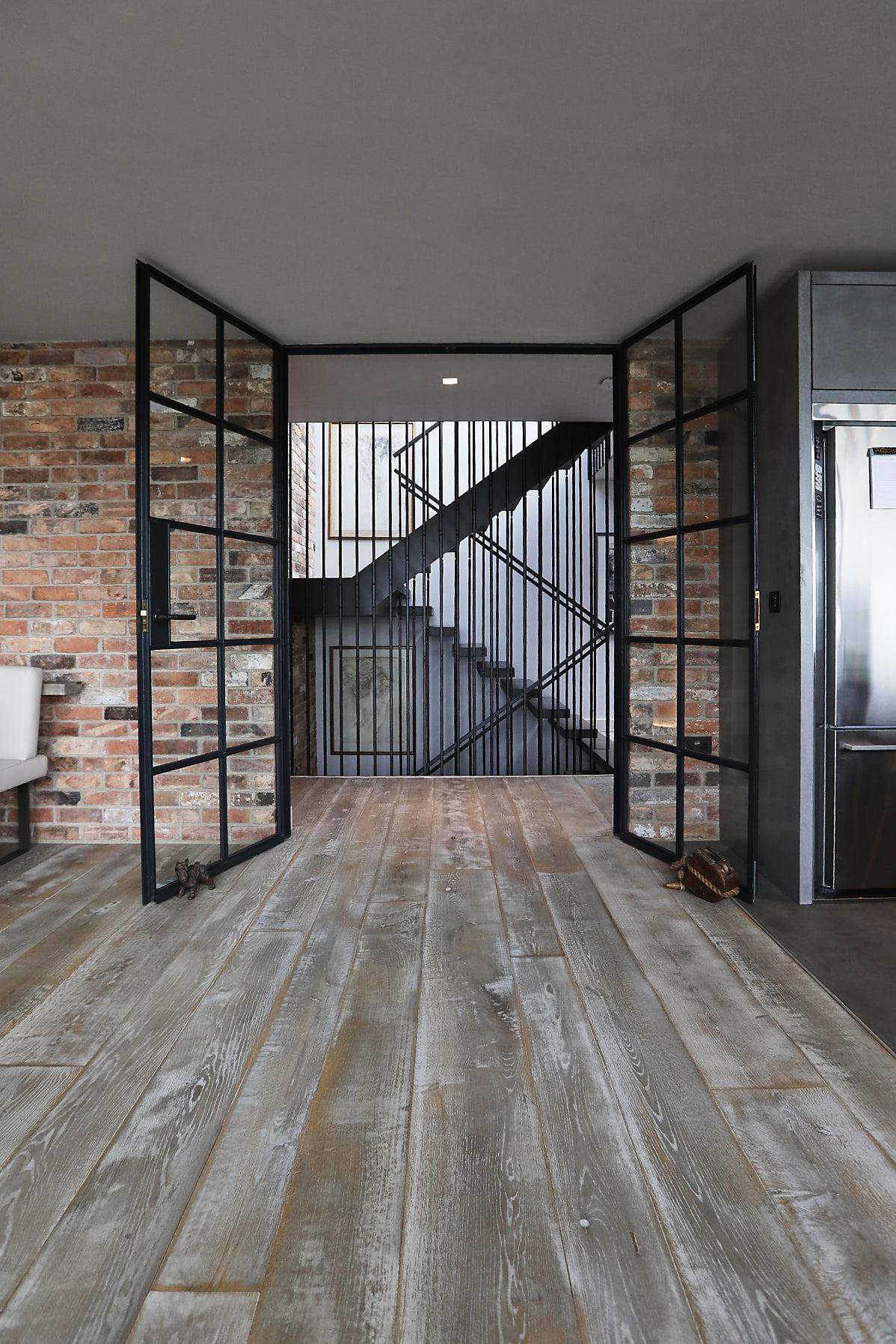 Black steel doors in entrance of kitchen