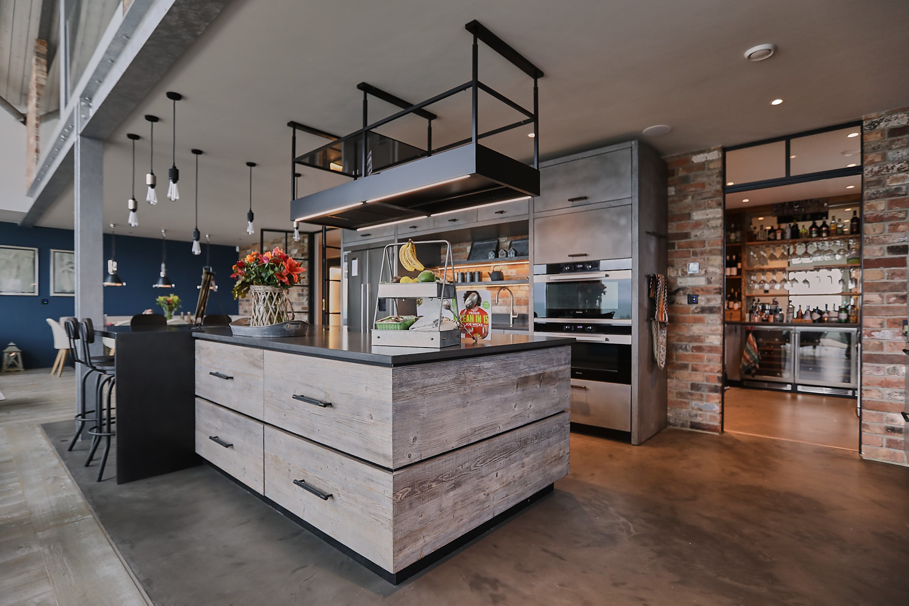 Mixing concrete, zinc and reclaimed wood in bespoke kitchen