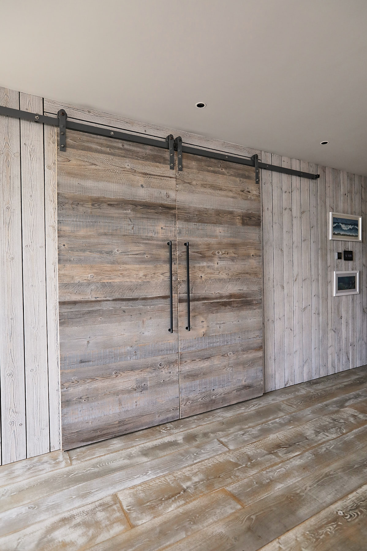 Rustic sliding barn doors with metal track rail