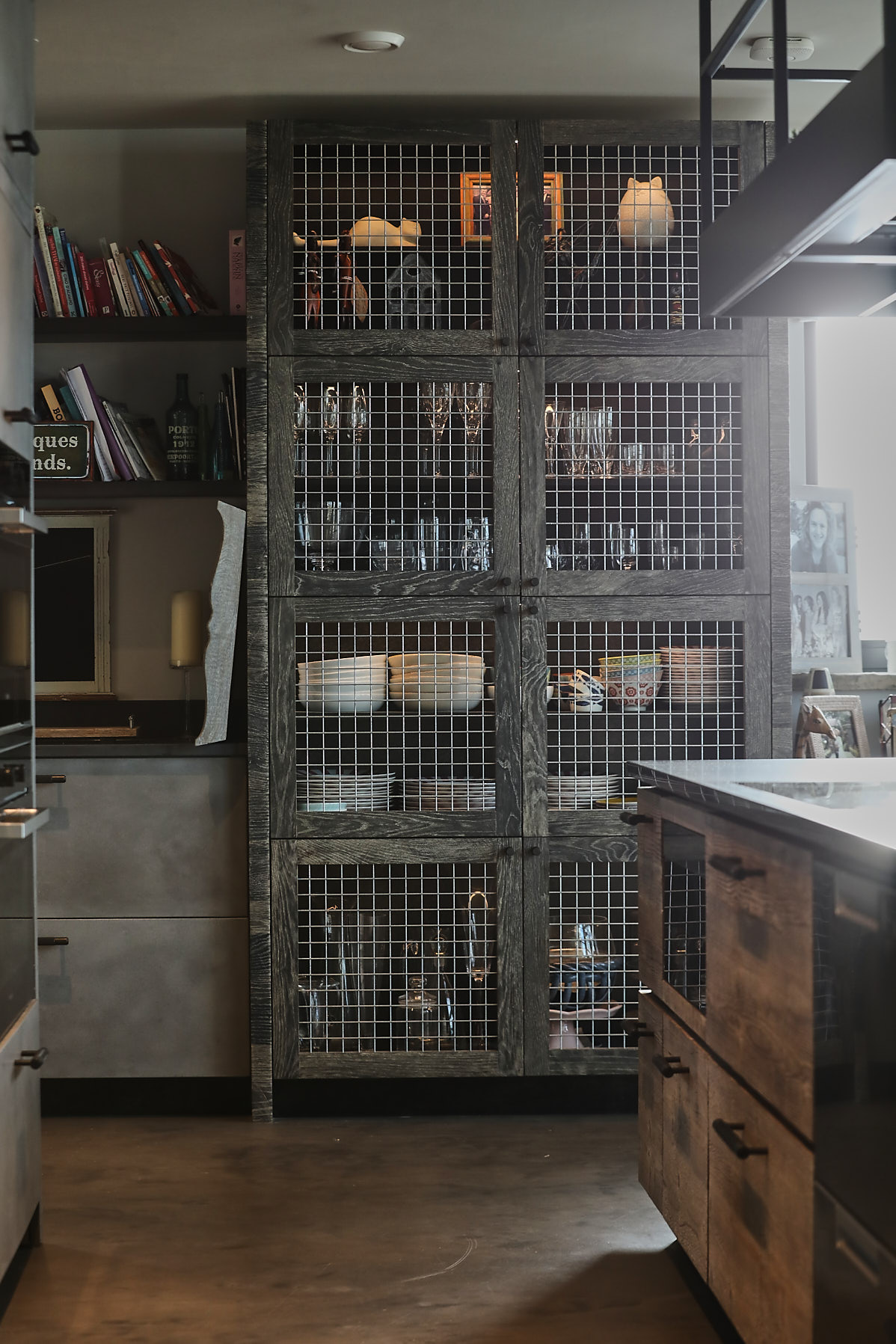 Wire and oak tall kitchen cabinet with concrete floor