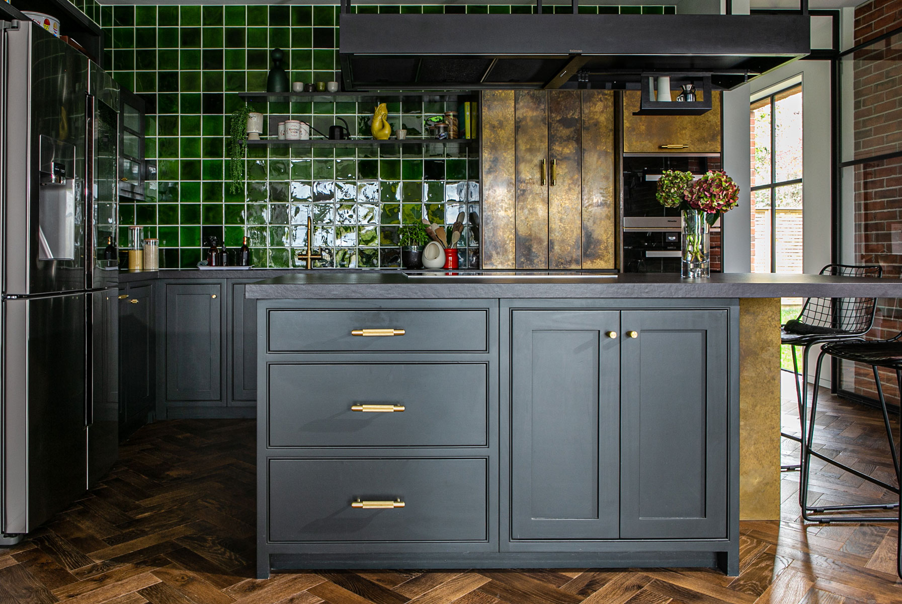 Bespoke kitchen island with painted cabinets and buster punch brass handles