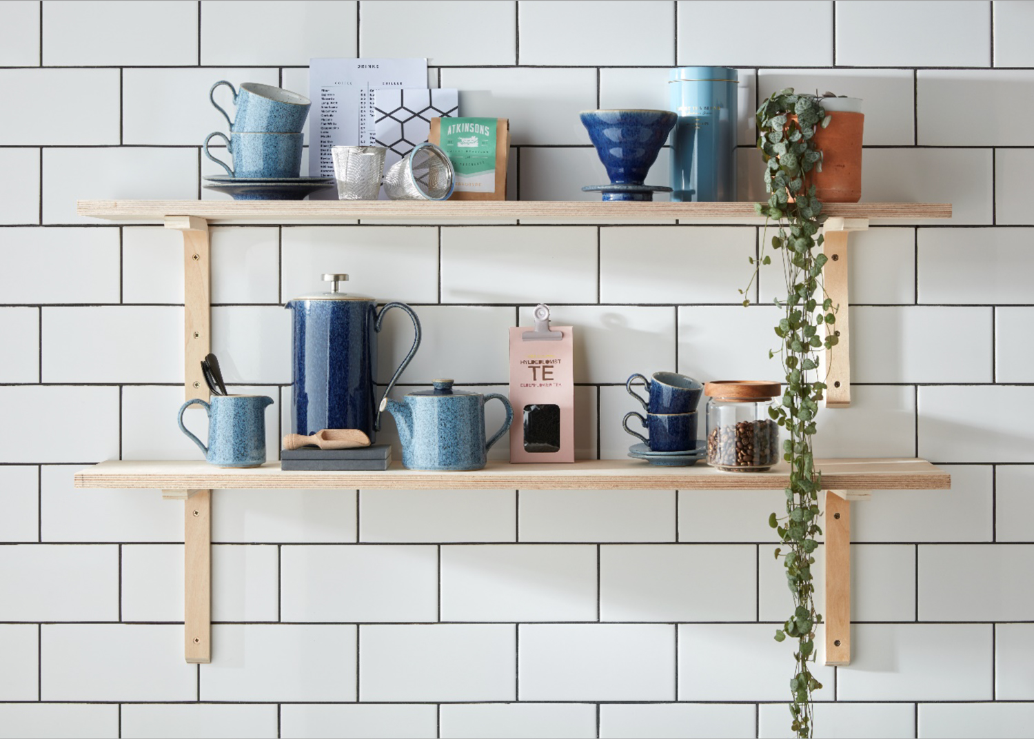Coffee and mugs on plywood shelves in the kitchen
