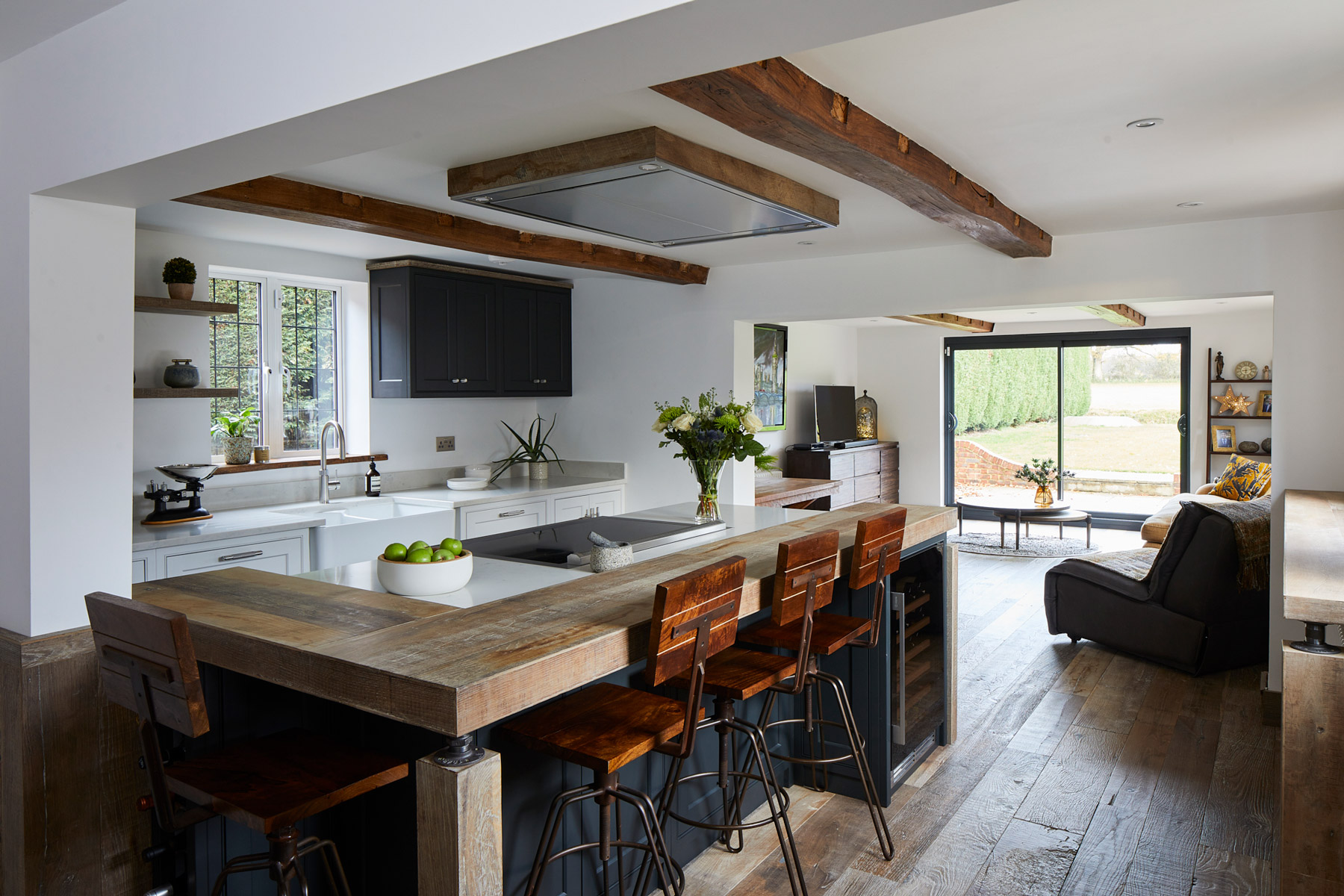 Industrial kitchen with reclaimed oak breakfast bar and painted dark island
