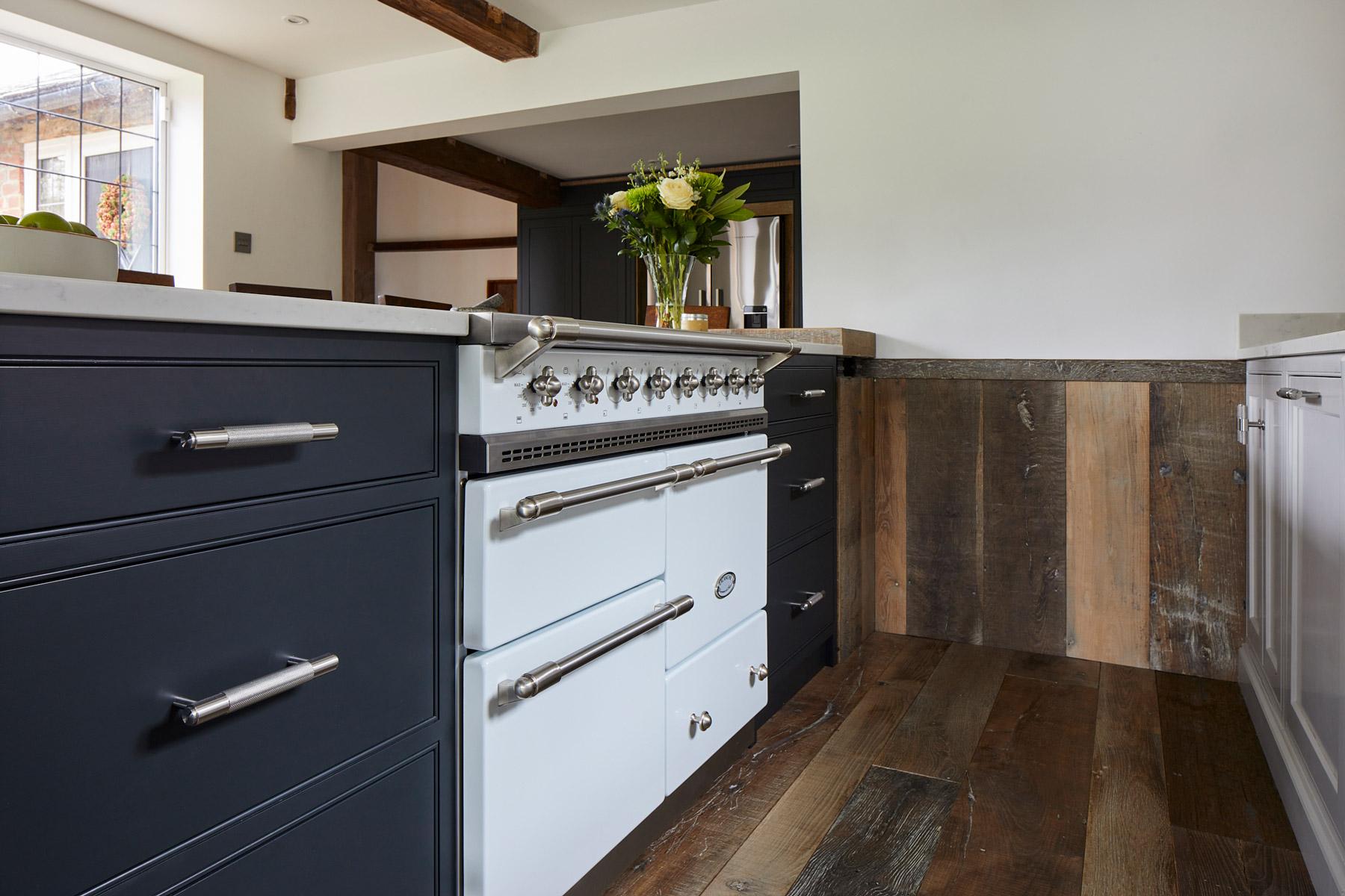 White Lacanche Macon next to Lamp Black kitchen cabinets