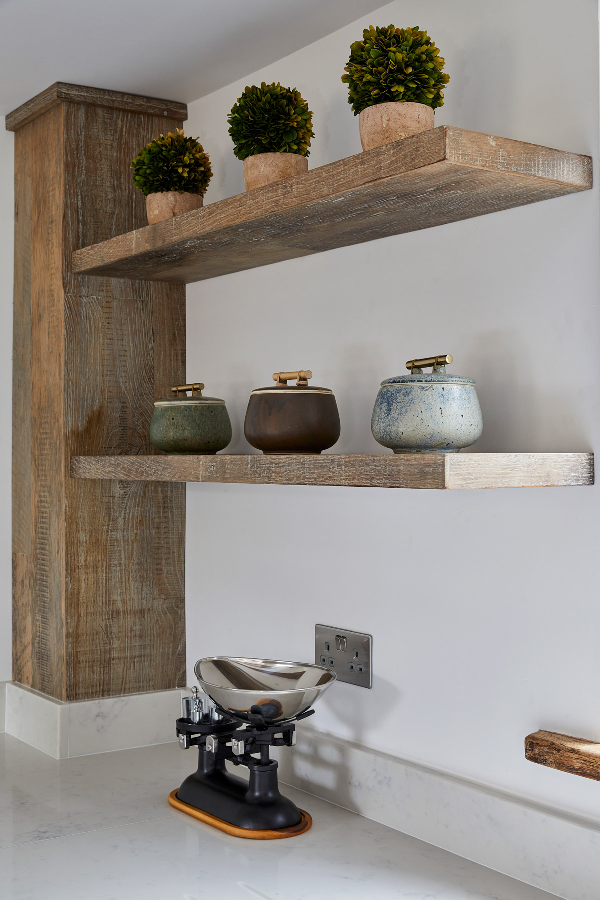 Chunky rustic oak open shelves with weighing scales