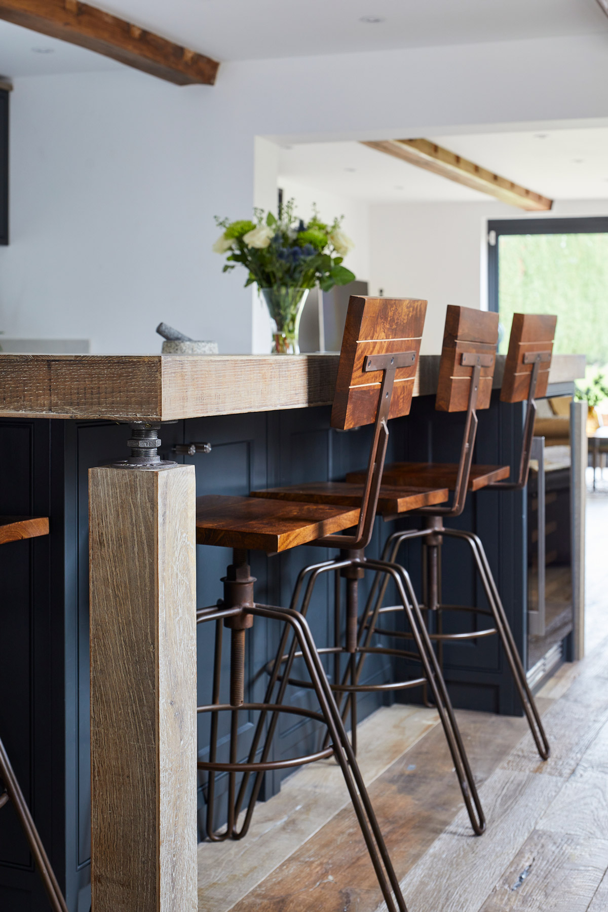 Industrial bar stool with wooden seat and backrest