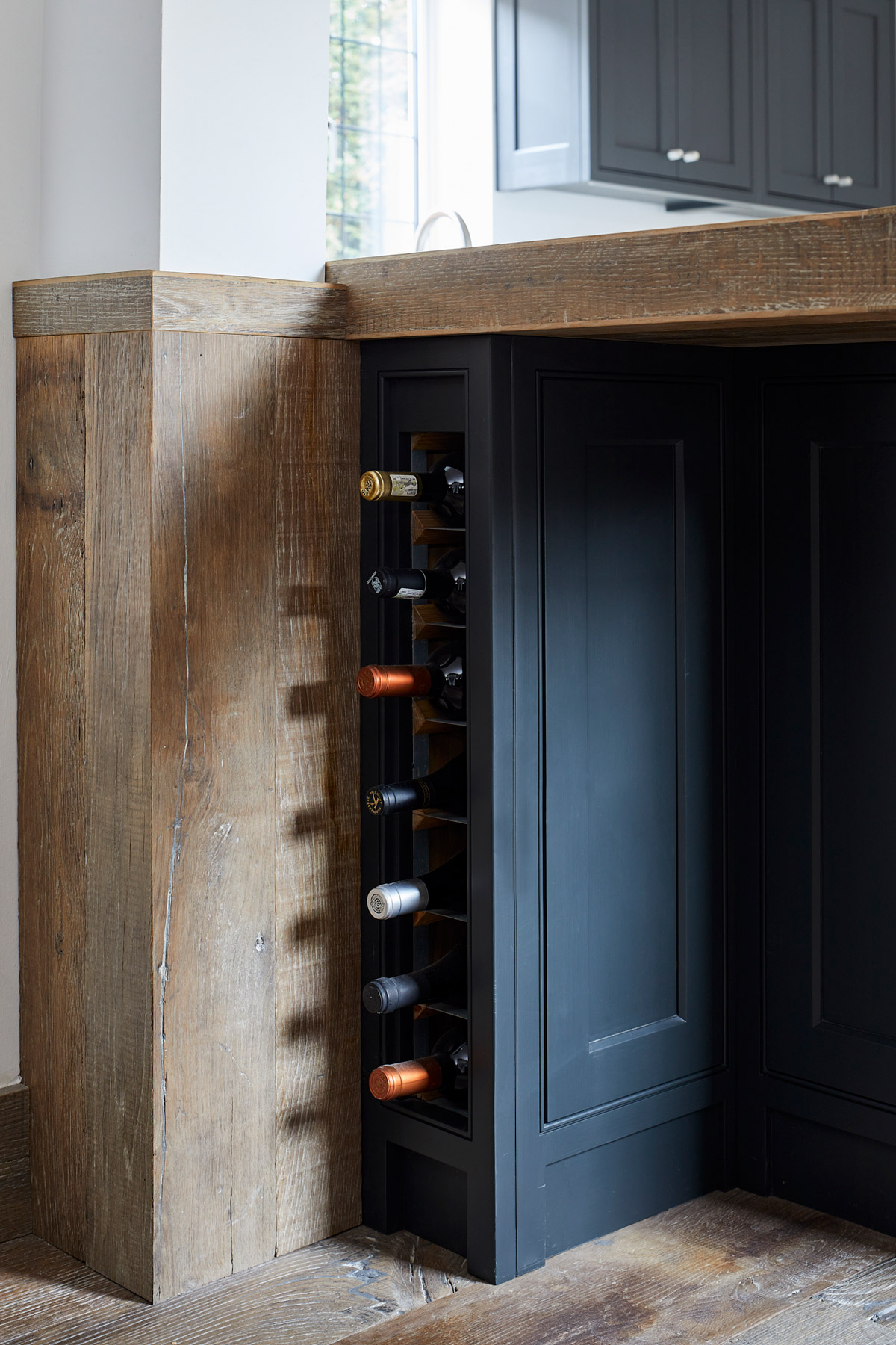 Slim kitchen wine rack in painted cabinets