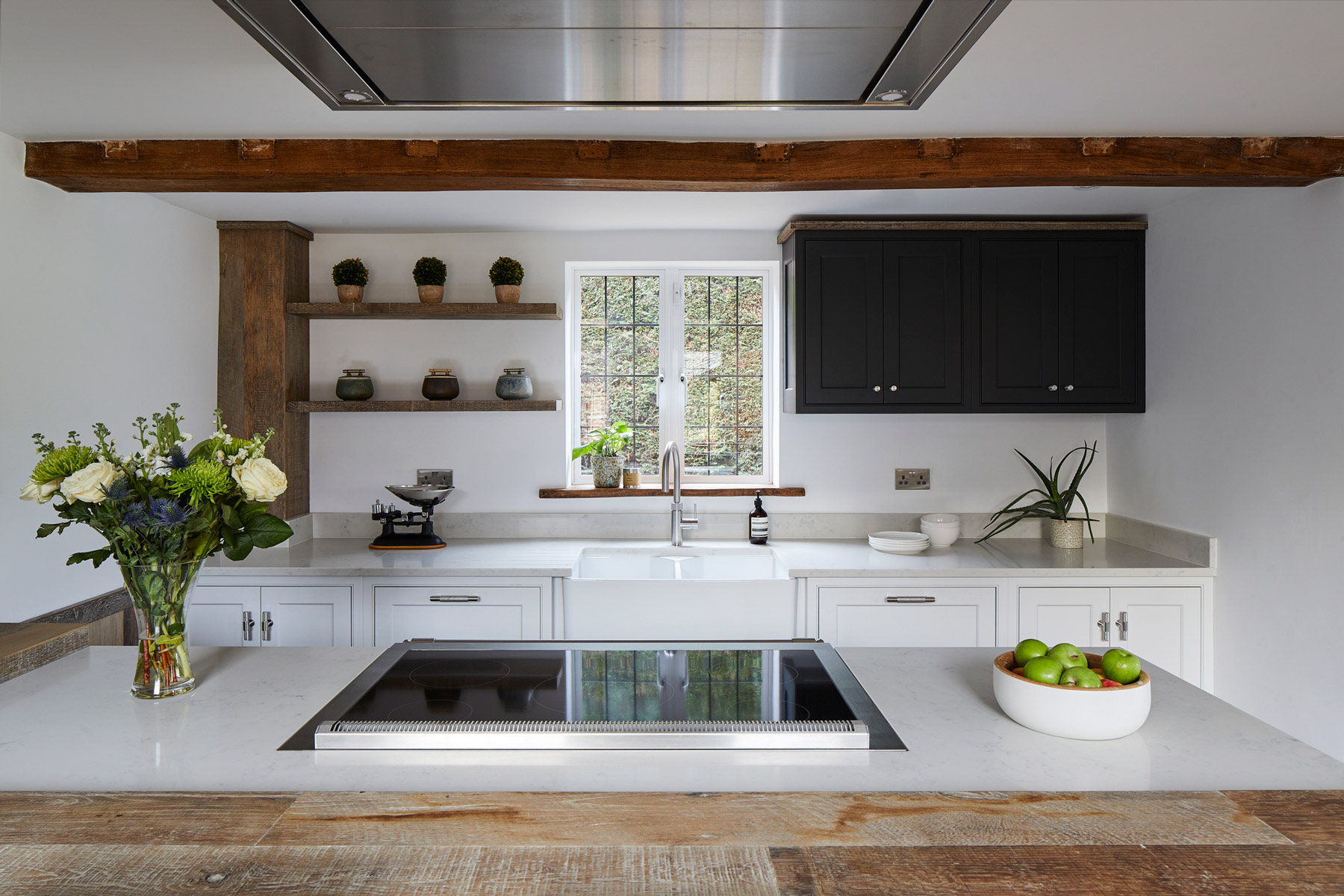 Bespoke painted kitchen with open shelves and dark wall cabinet on sink run