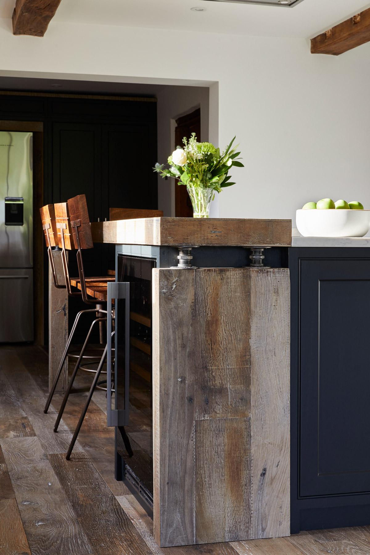 Chunky reclaimed oak kitchen breakfast bar with steel pipes