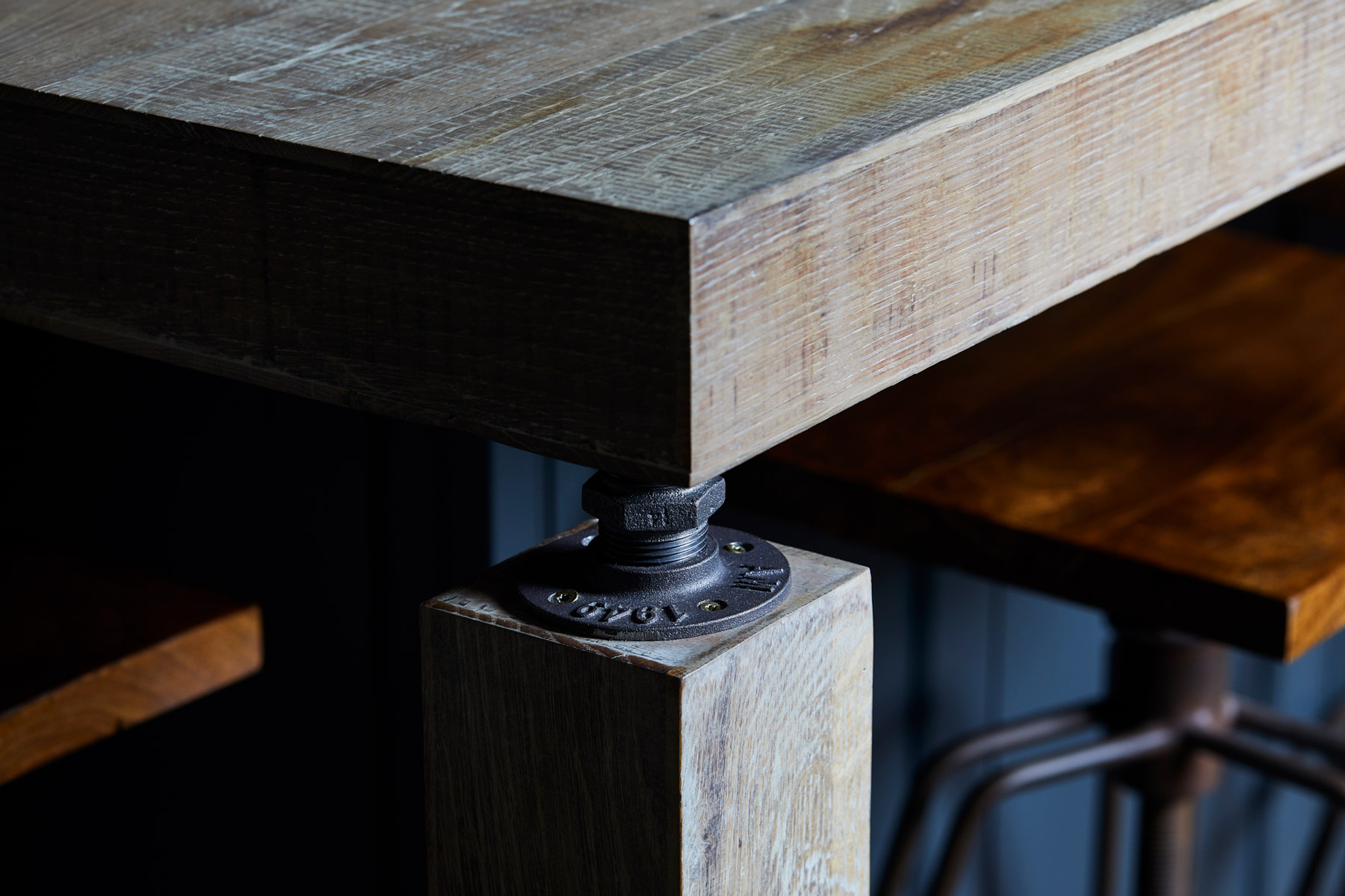 Thick reclaimed oak kitchen breakfast bar with iron pipework