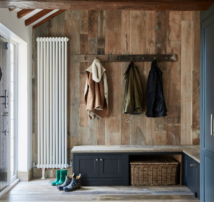 Painted boot room cabinets against reclaimed wall cladding