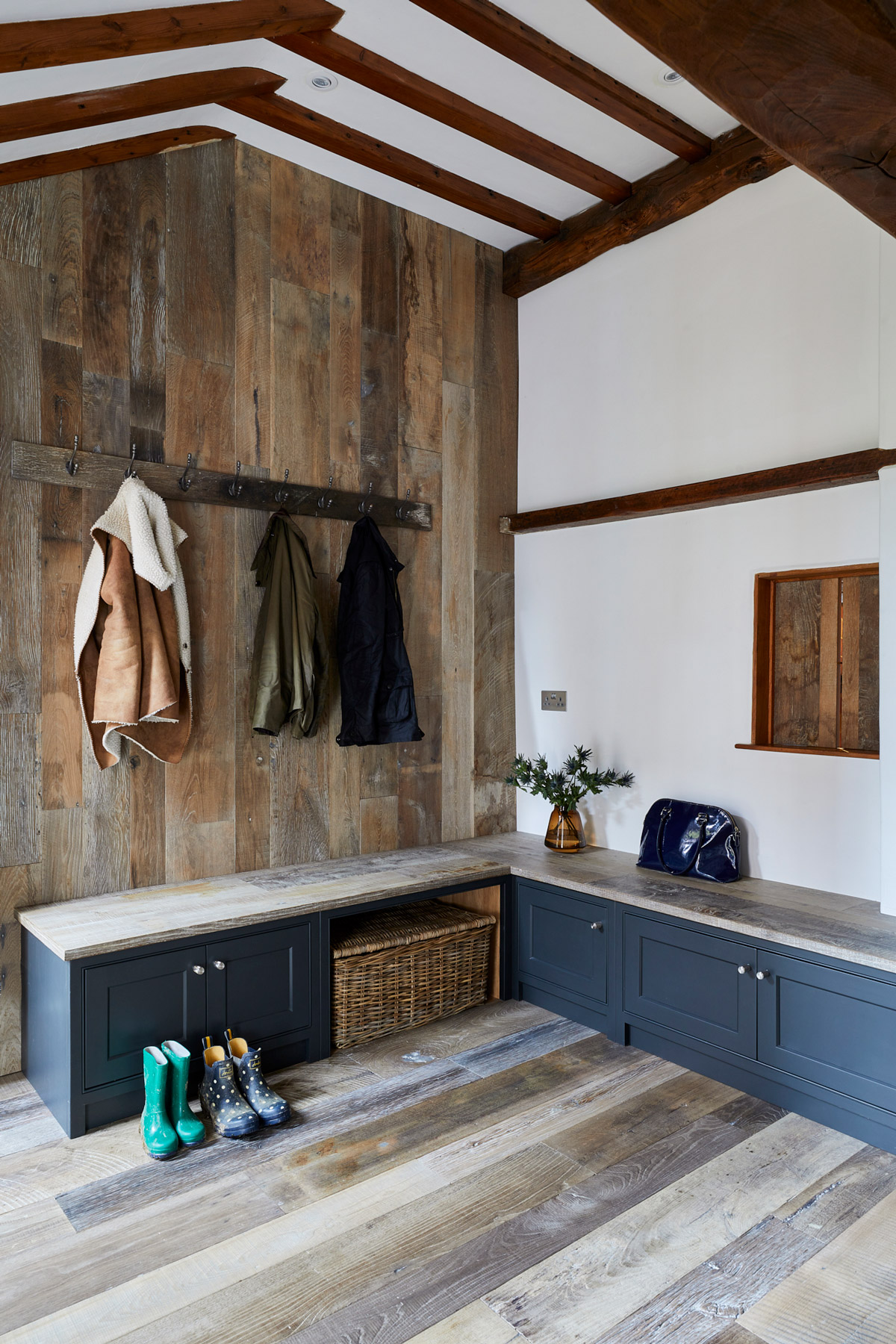 Boot cupboards with reclaimed oak seating and reclaimed oak cladded walls