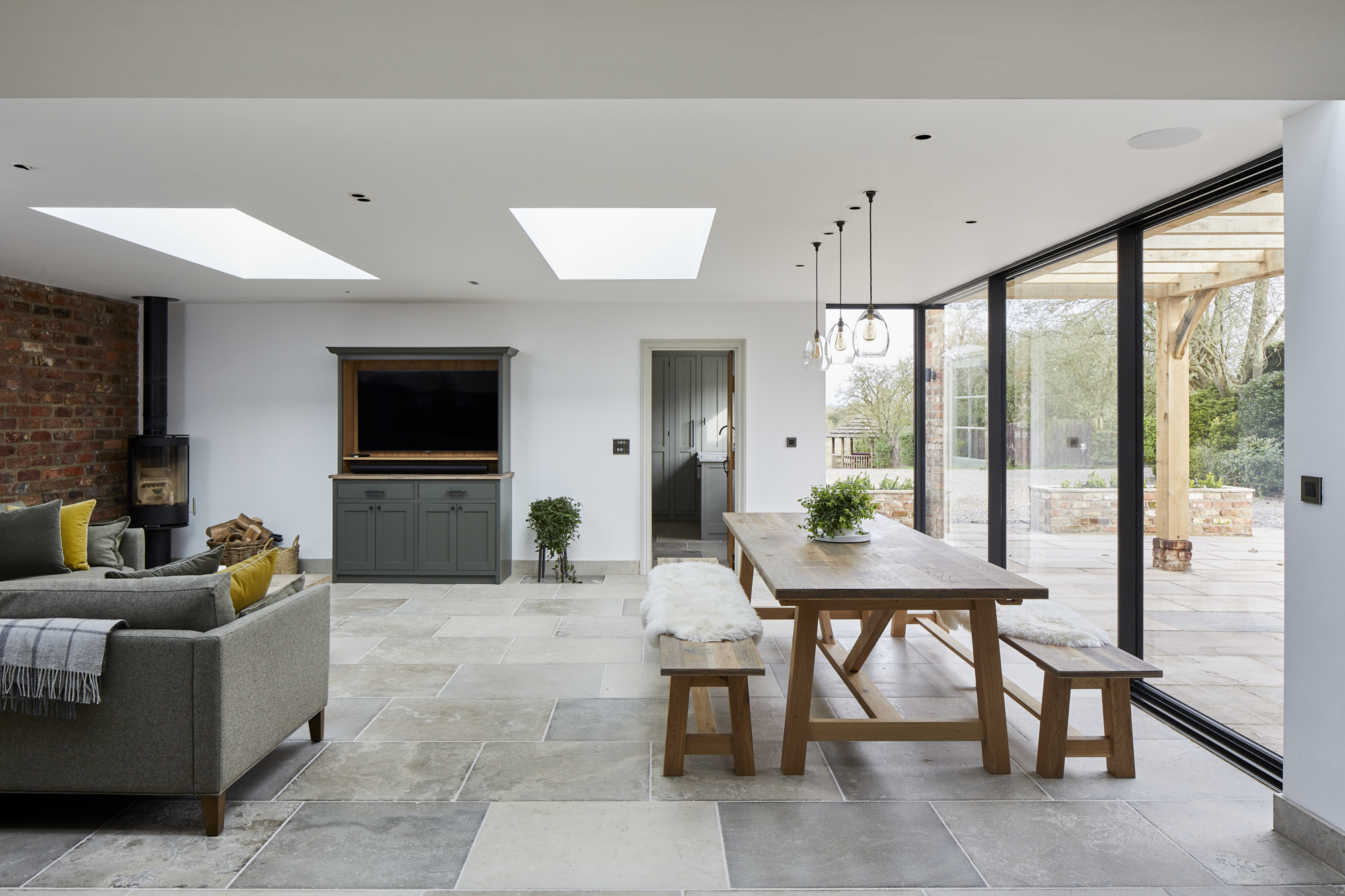 Open plan dining room with oak table