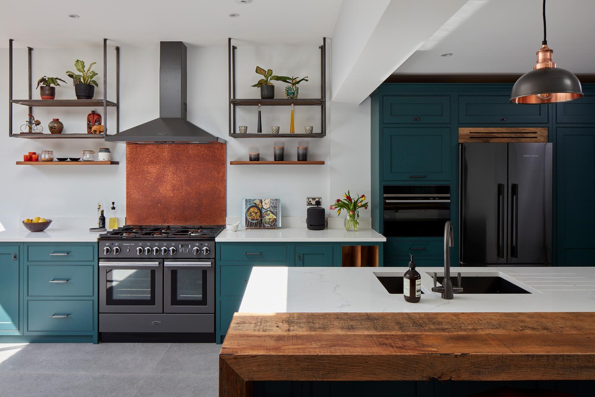 Copper back splash behind range cooker
