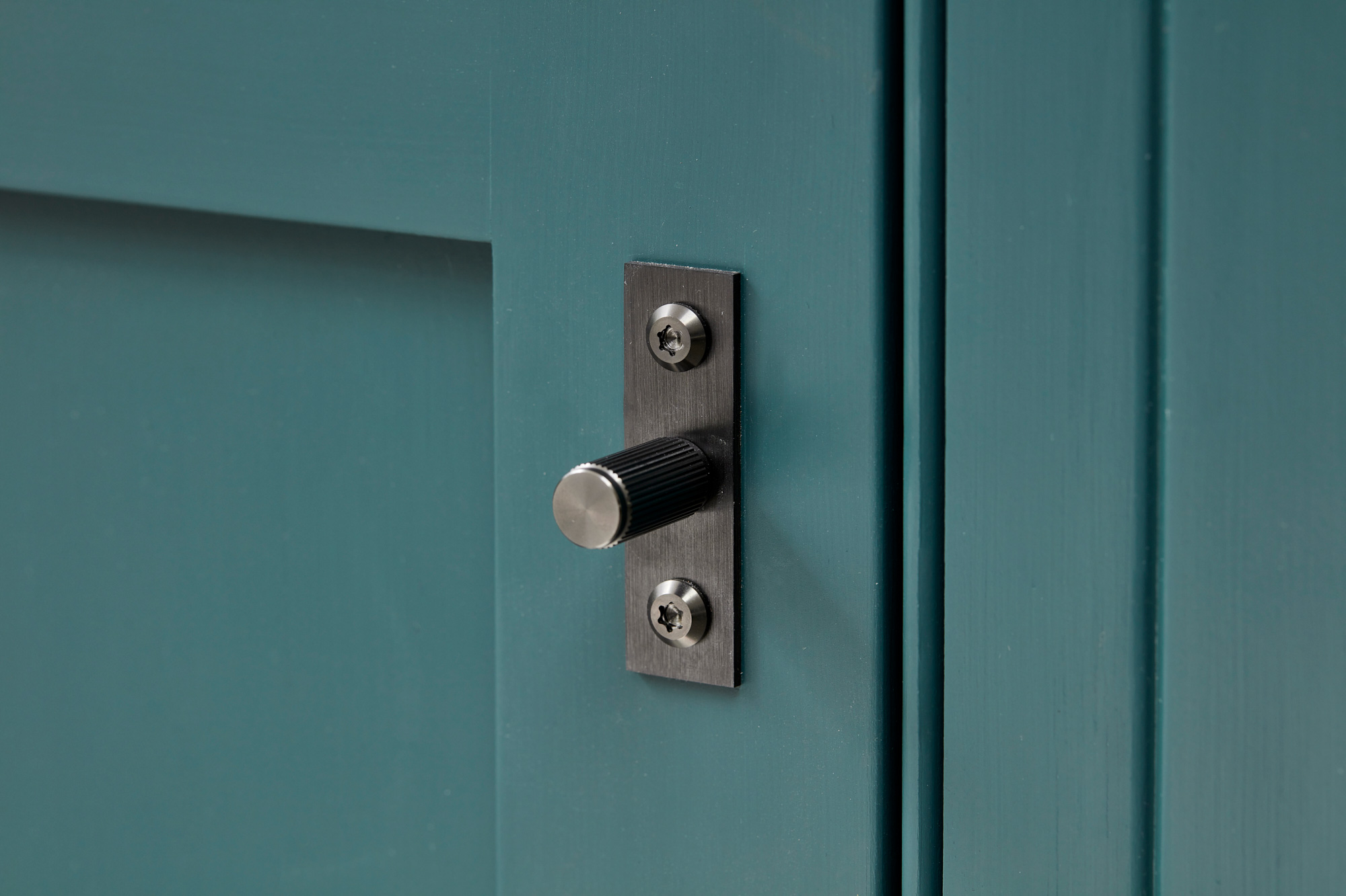 Buster and Punch pull handle on painted Little Greene kitchen