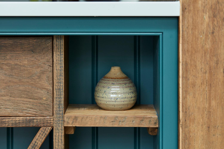 Ceramic vase in open kitchen island