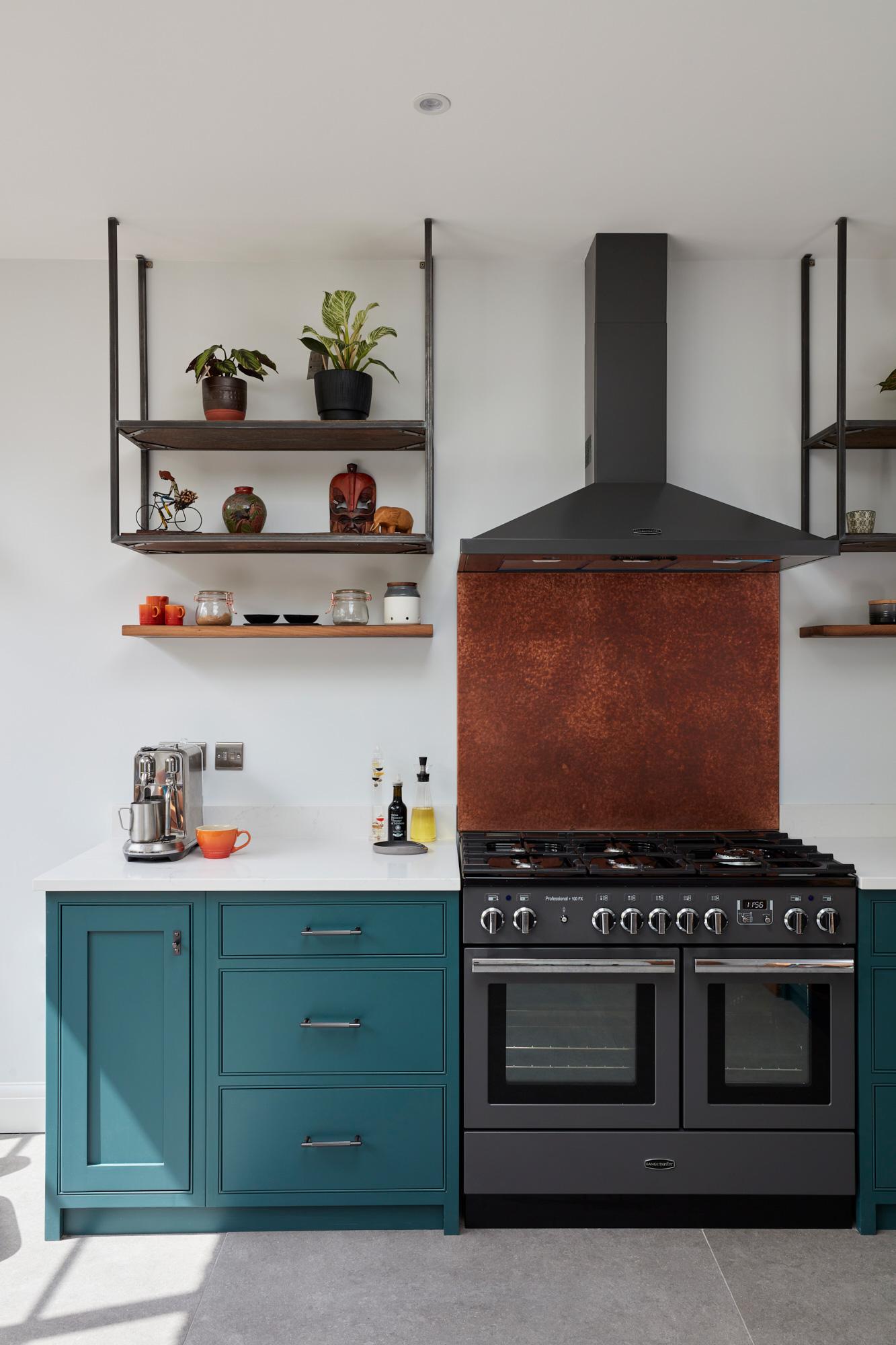 Copper backsplash and open industrial shelves in bespoke painted kitchen