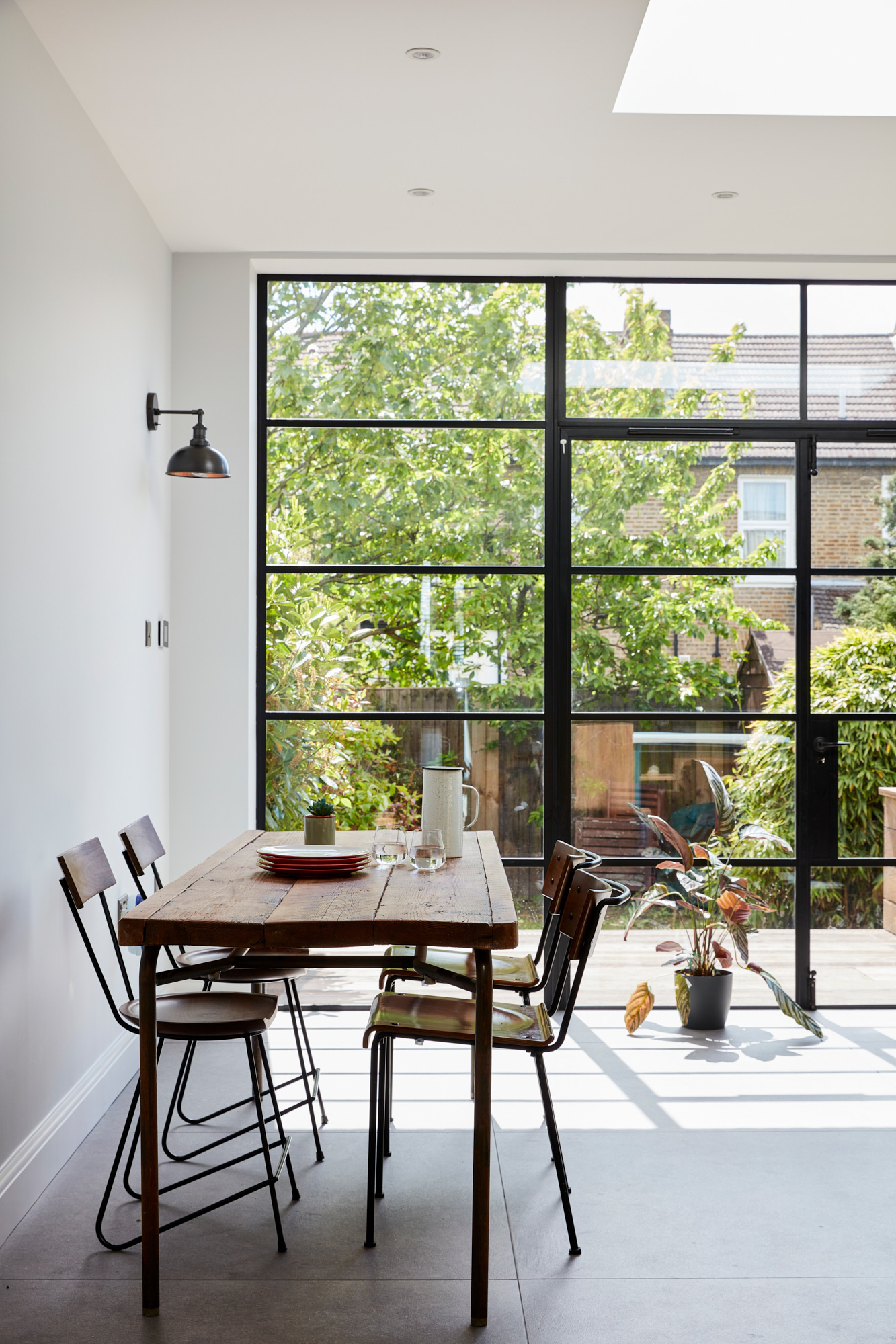 Crittall style doors with reclaimed oak kitchen table