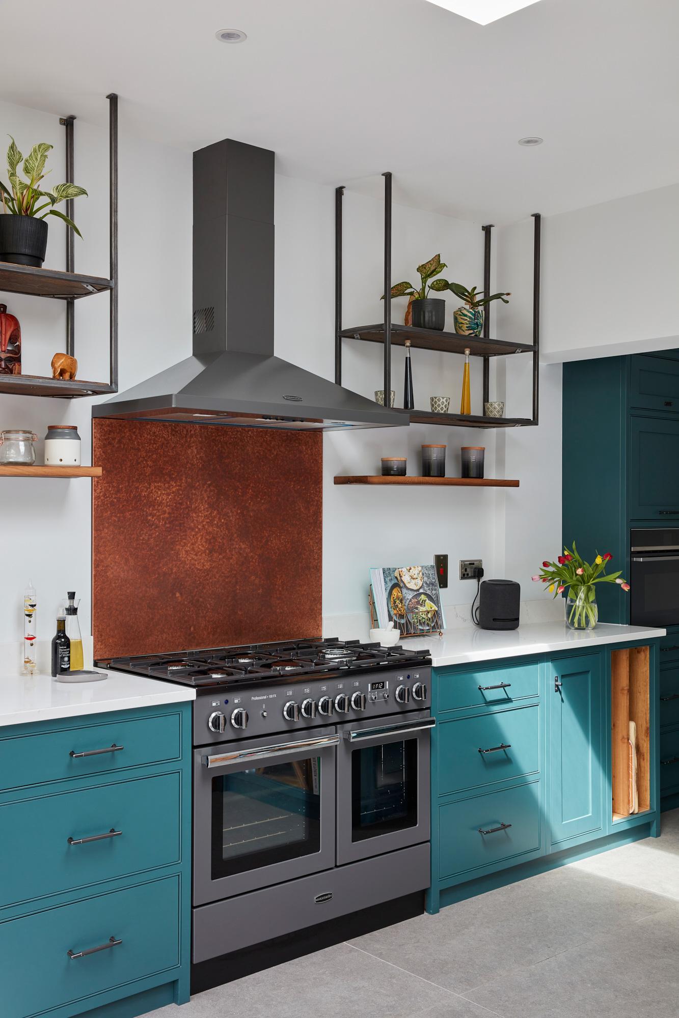 Copper backsplash in bespoke painted industrial kitchen