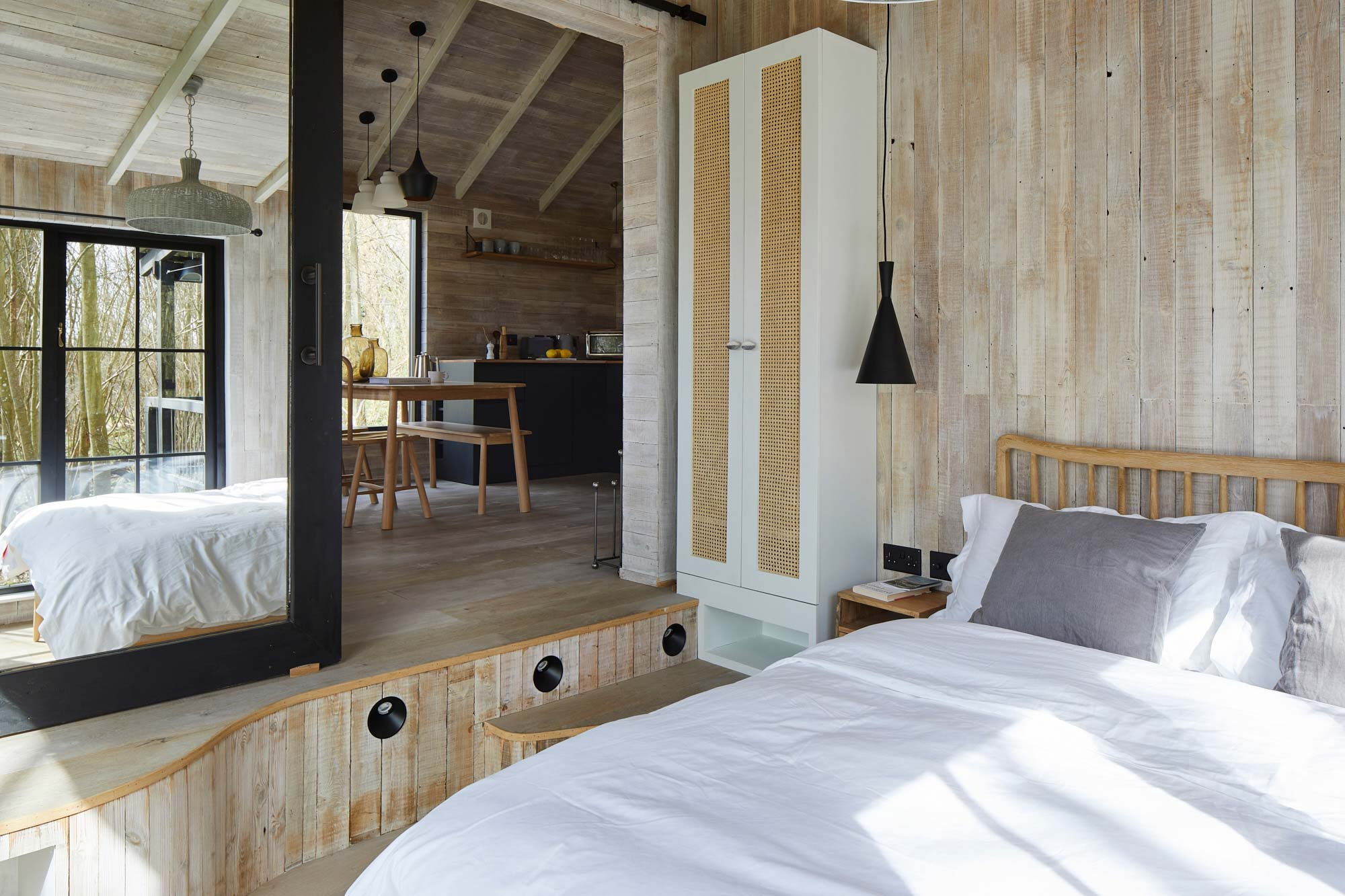 Bedroom cladded in reclaimed timber