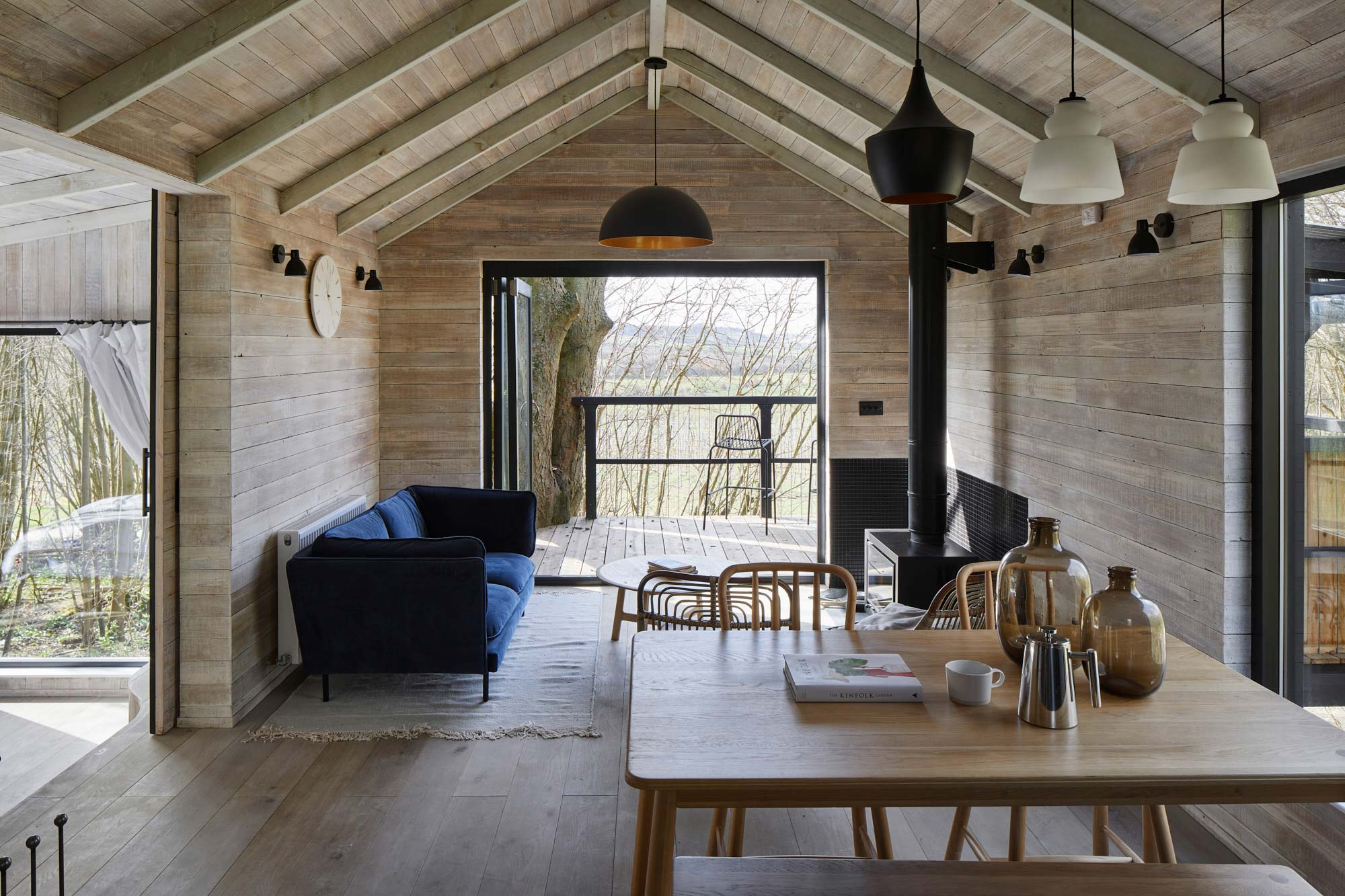 Open plan treehouse living room and kitchen