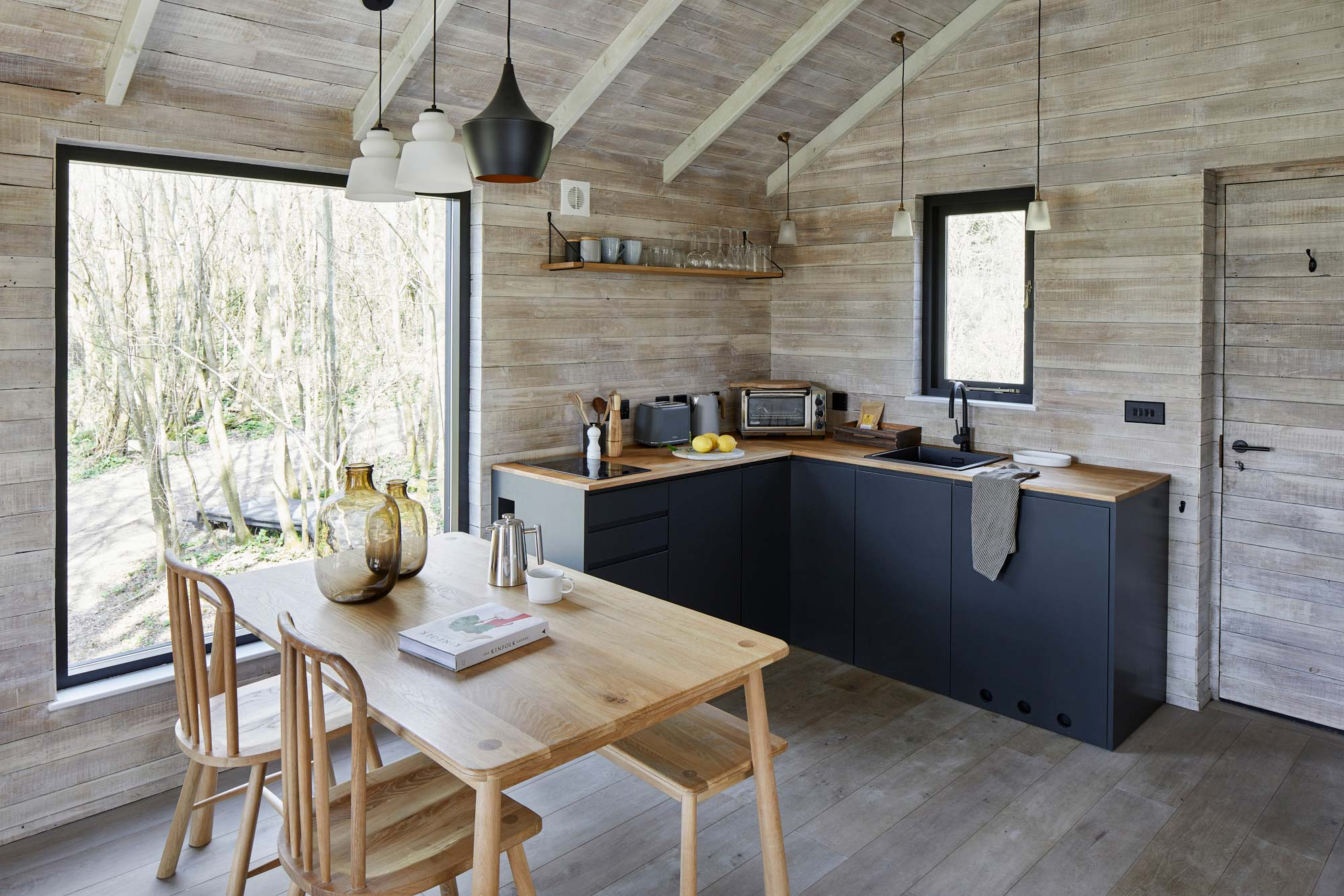 Reclaimed cladded treehouse kitchen