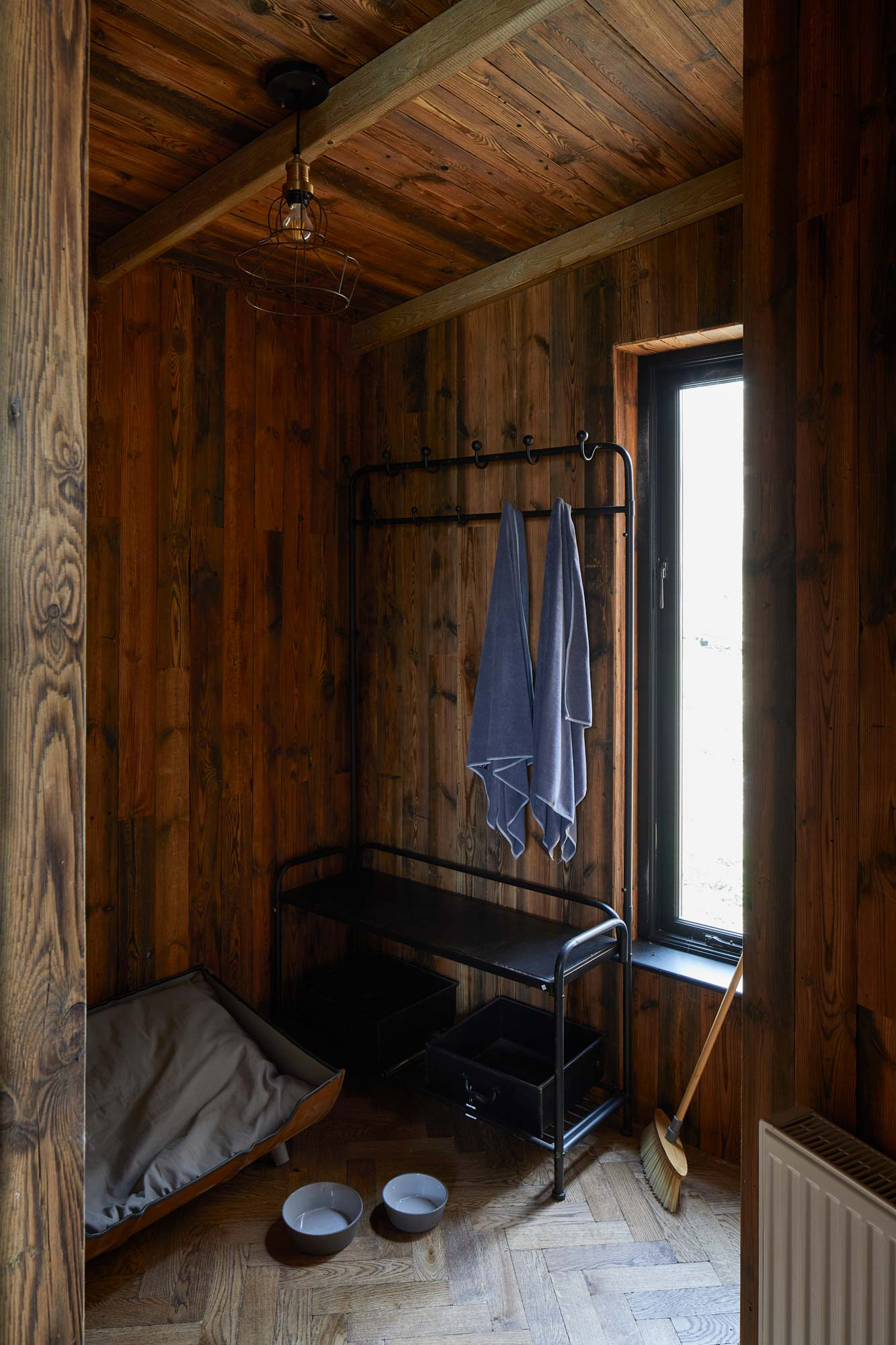 Reclaimed cladding and parquet flooring in bespoke treehouse