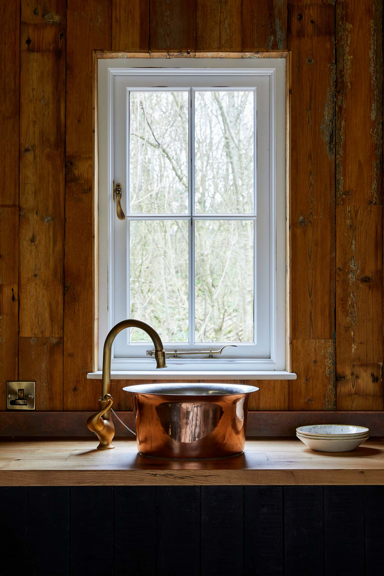 Reclaimed mill pine cladding in treehouse kitchen