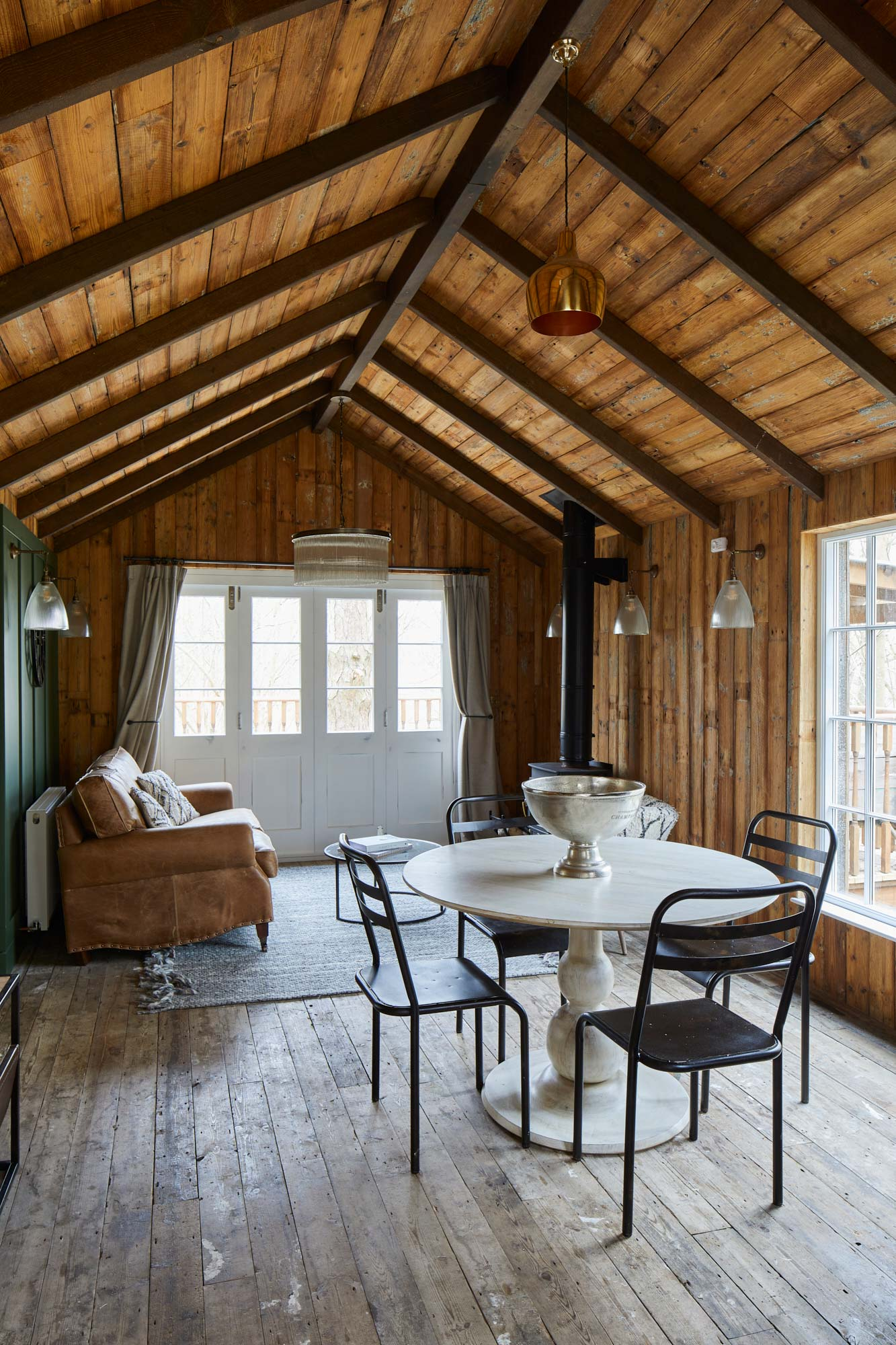 Reclaimed wood flooring and cladding in treehouse